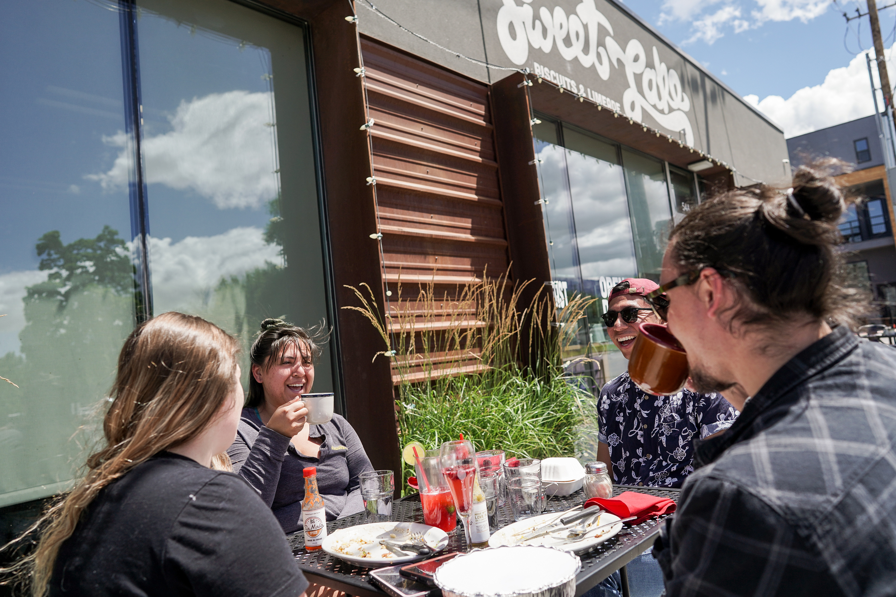 Trae Groshong, Mari Mosqueda, Erick Pablo and Auston Garcich, left to right, chat as they wrap up a meal at Sweet Lake Biscuits & Limeade in Salt Lake City on Wednesday, June 17, 2020.