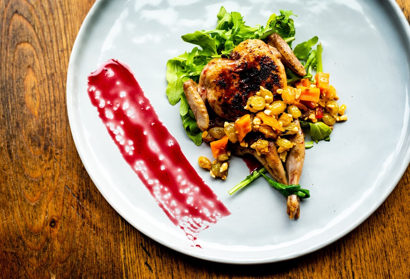 Pomegranate glazed quail at Twisted Soul Cookhouse and Pours in Atlanta, GA