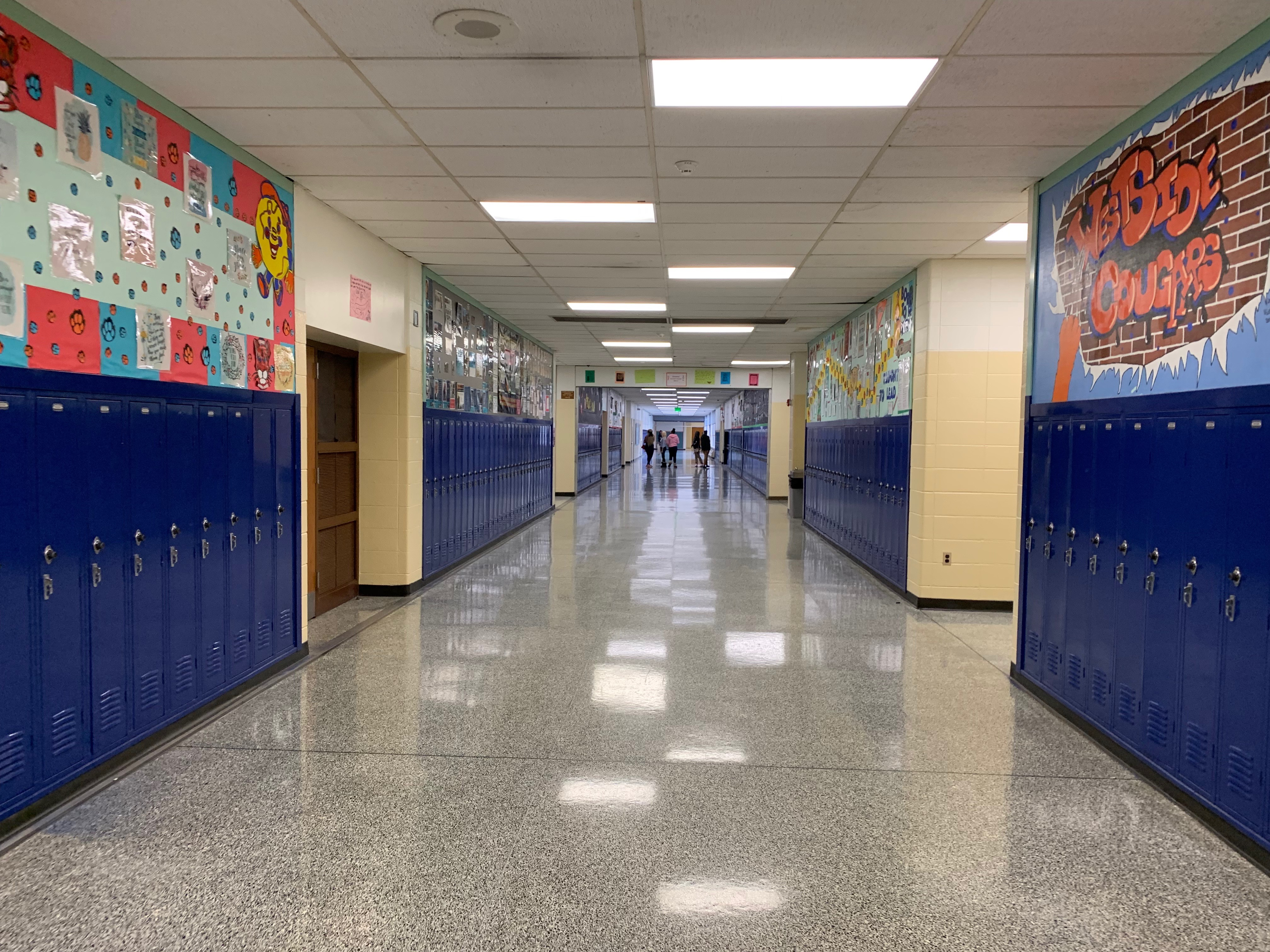Students walk down a mostly empty hallway in Gary's West Side Leadership Academy in December 2019.