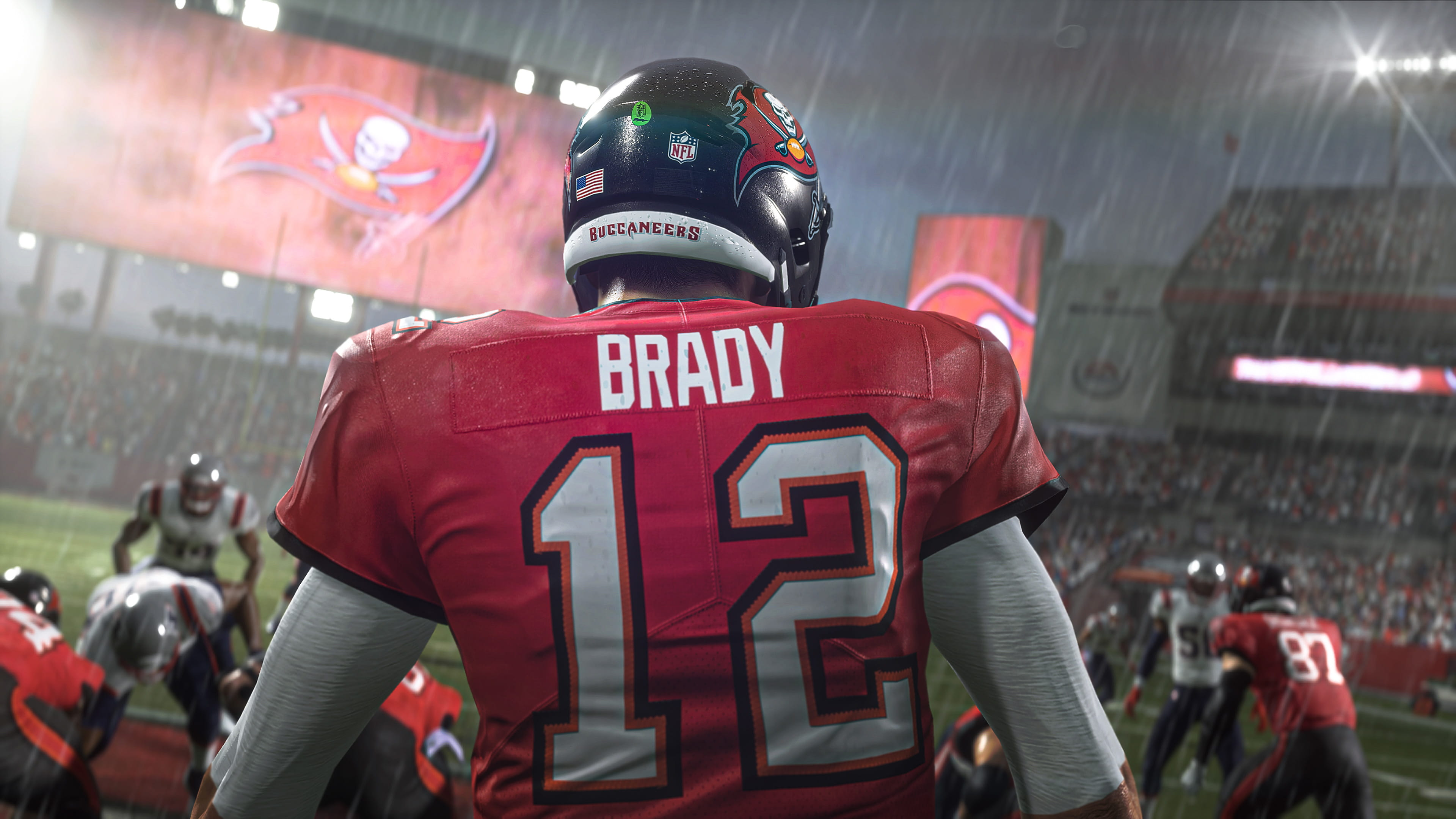 a close-up from behind Tampa Bay Buccaneers quarterback Tom Brady at the line of scrimmage in Madden NFL 21