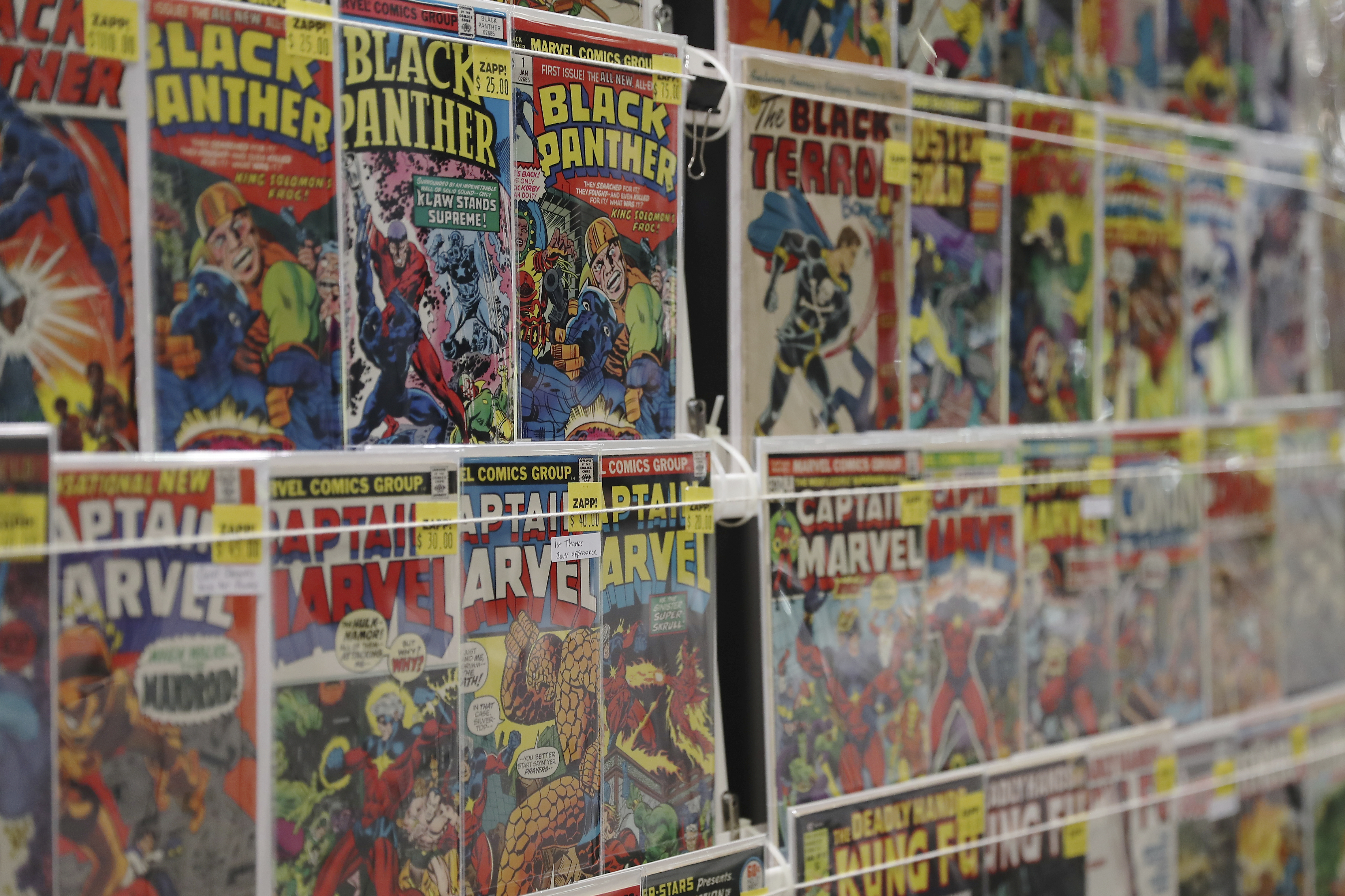 A general view of comic books set up at the Javits Center on the first day of New York Comic Con, Thursday, Oct. 3, 2019, in New York. (AP Photo/Steve Luciano)