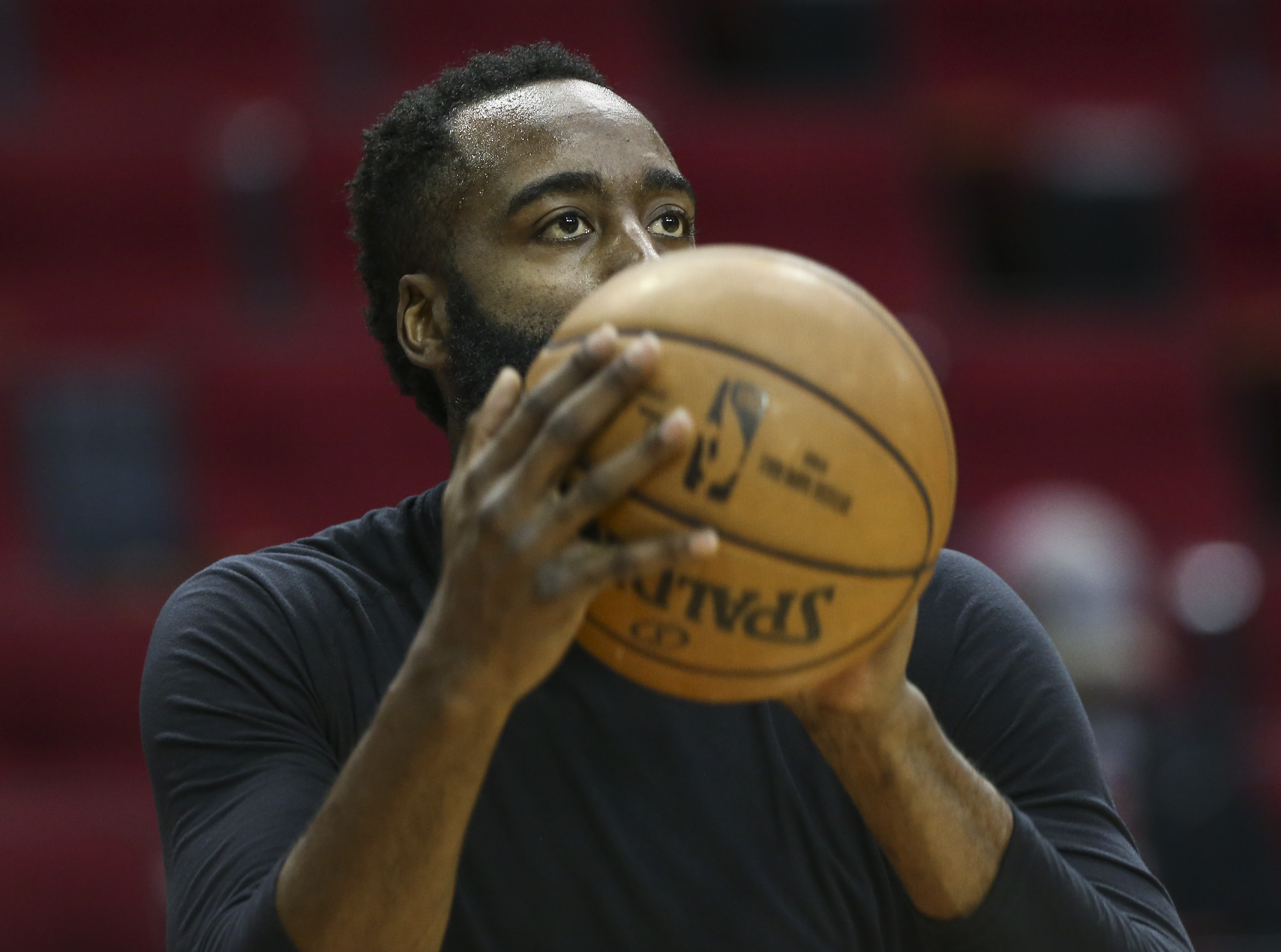 Houston Rockets guard James Harden warms up before a game against the New Orleans Pelicans at Toyota Center.