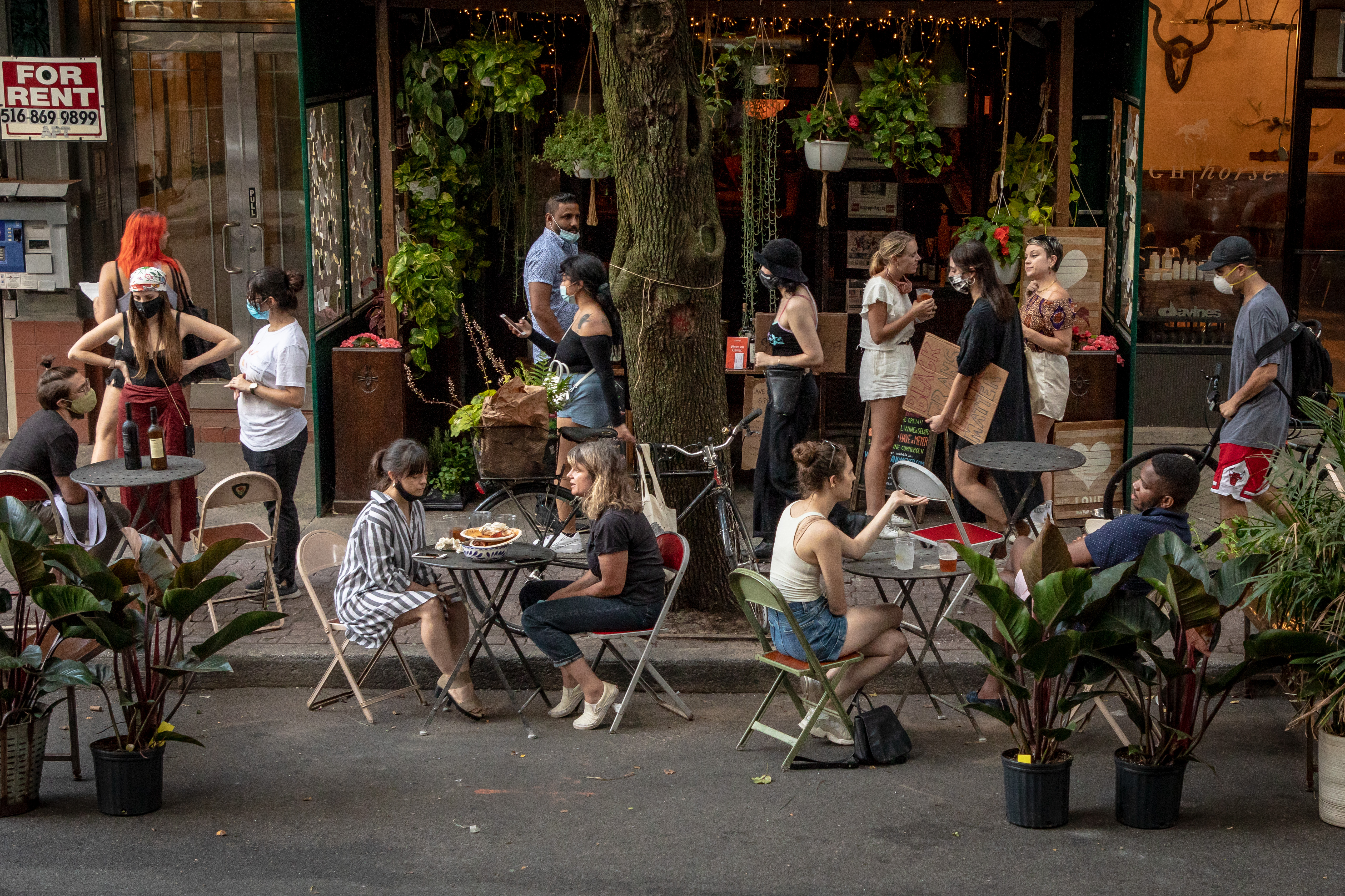 Customers dine at curbside tables