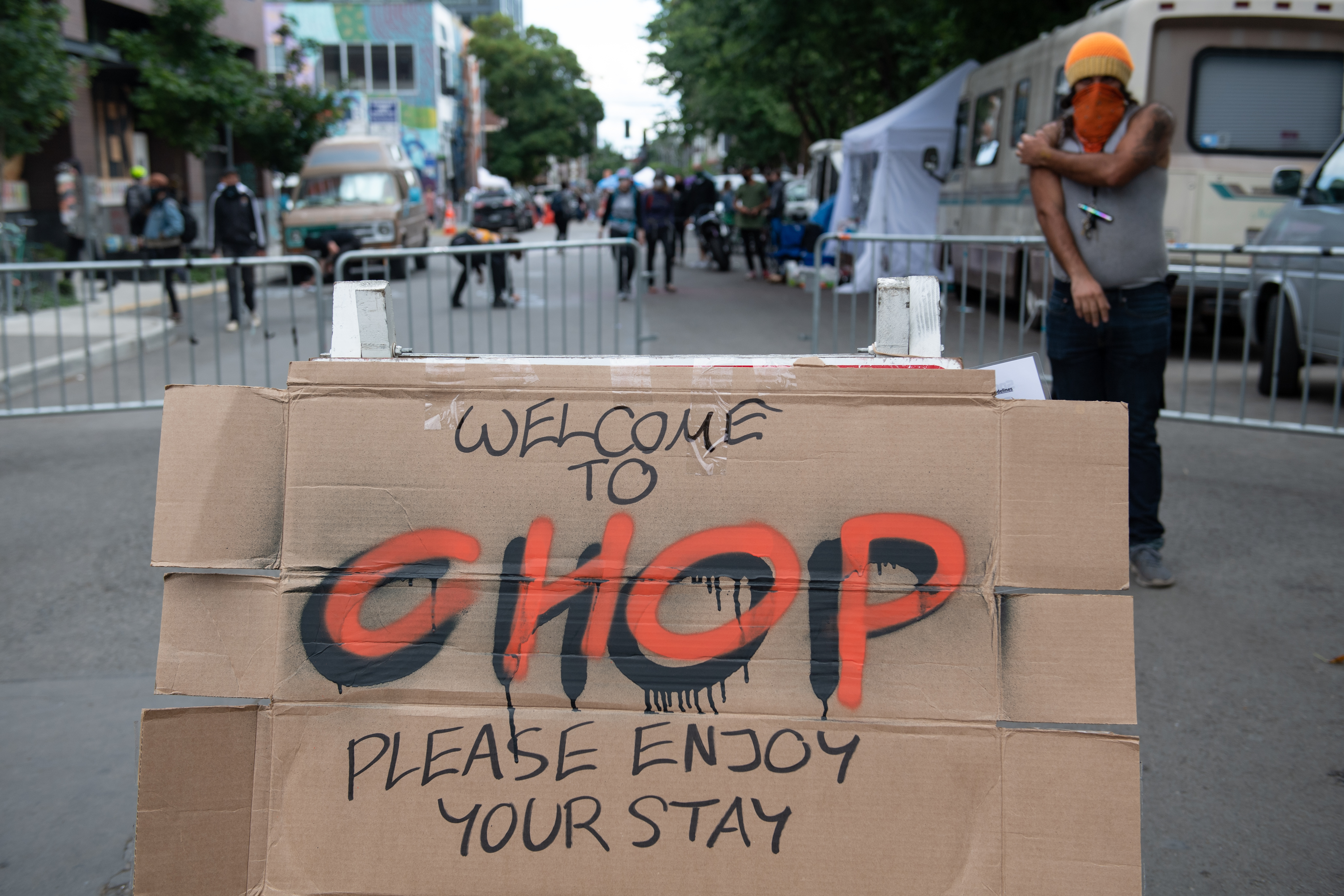 """Cardboard with the word """"CHOP"""" written on it. The cardboard is in the street of the Seattle Autonomous Zone, a police-free area also known as CHOP or CHAZ."""