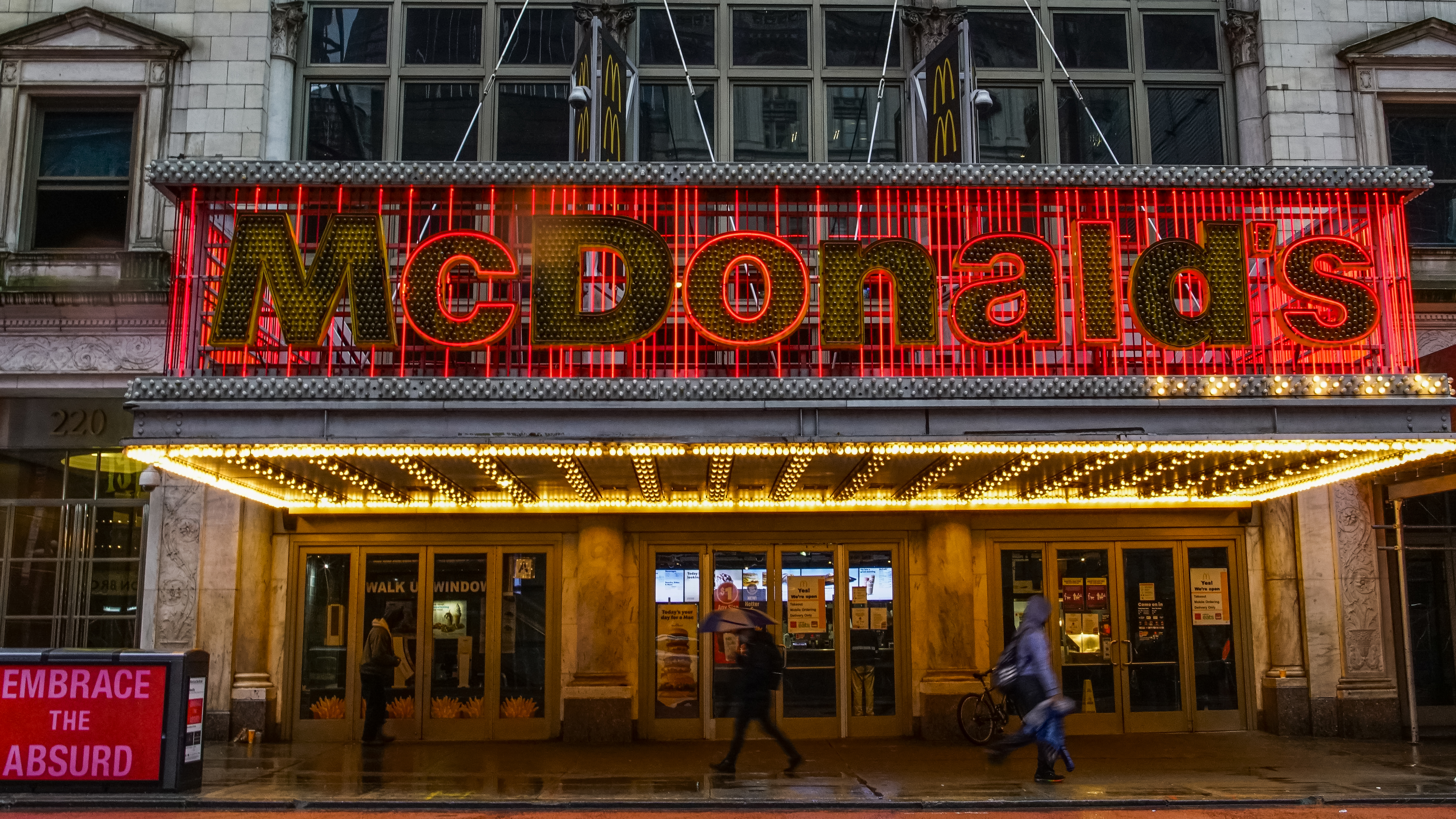 People walk in front of a McDonald's at Times Square on April 30, 2020 in New York City.