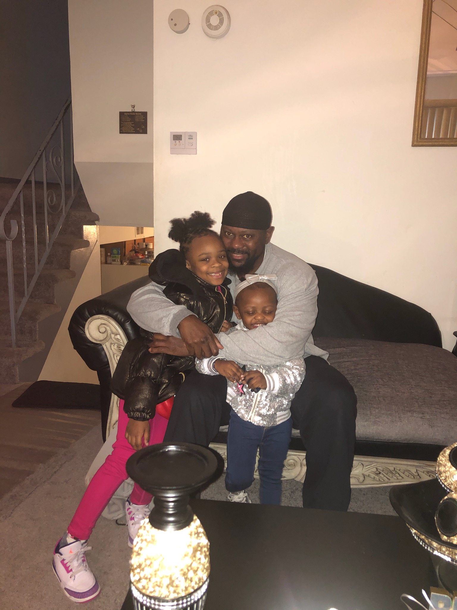 """Former Gangster Disciples """"governor"""" James Yates, freed from prison in April under the First Step Act, hugs his grandchildren at his South Side home. """"To sit in the yard and take in the fresh air, I don't really know how to put words on it,"""" he says."""