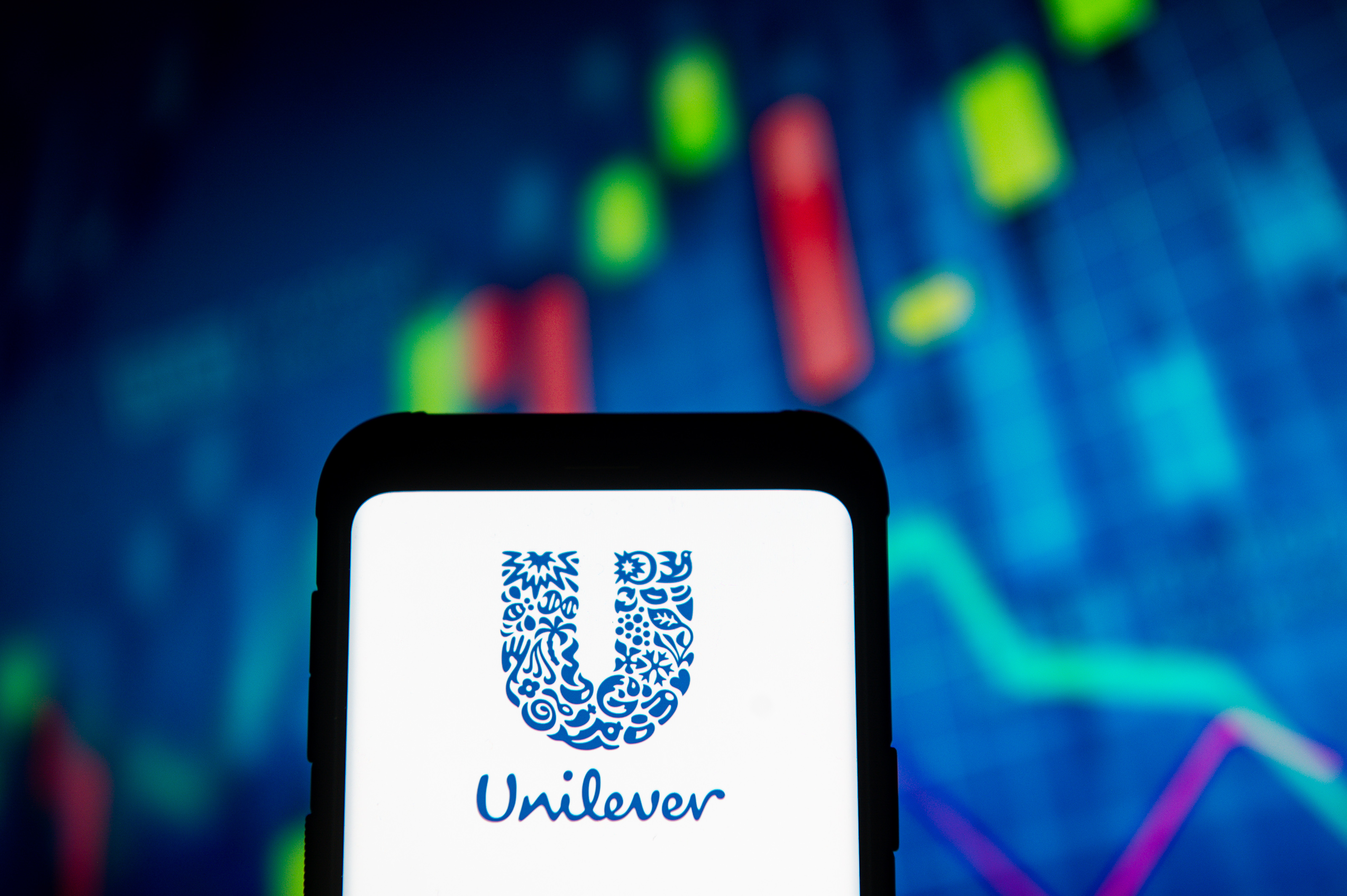 In this photo illustration the Unilever logo seen displayed...