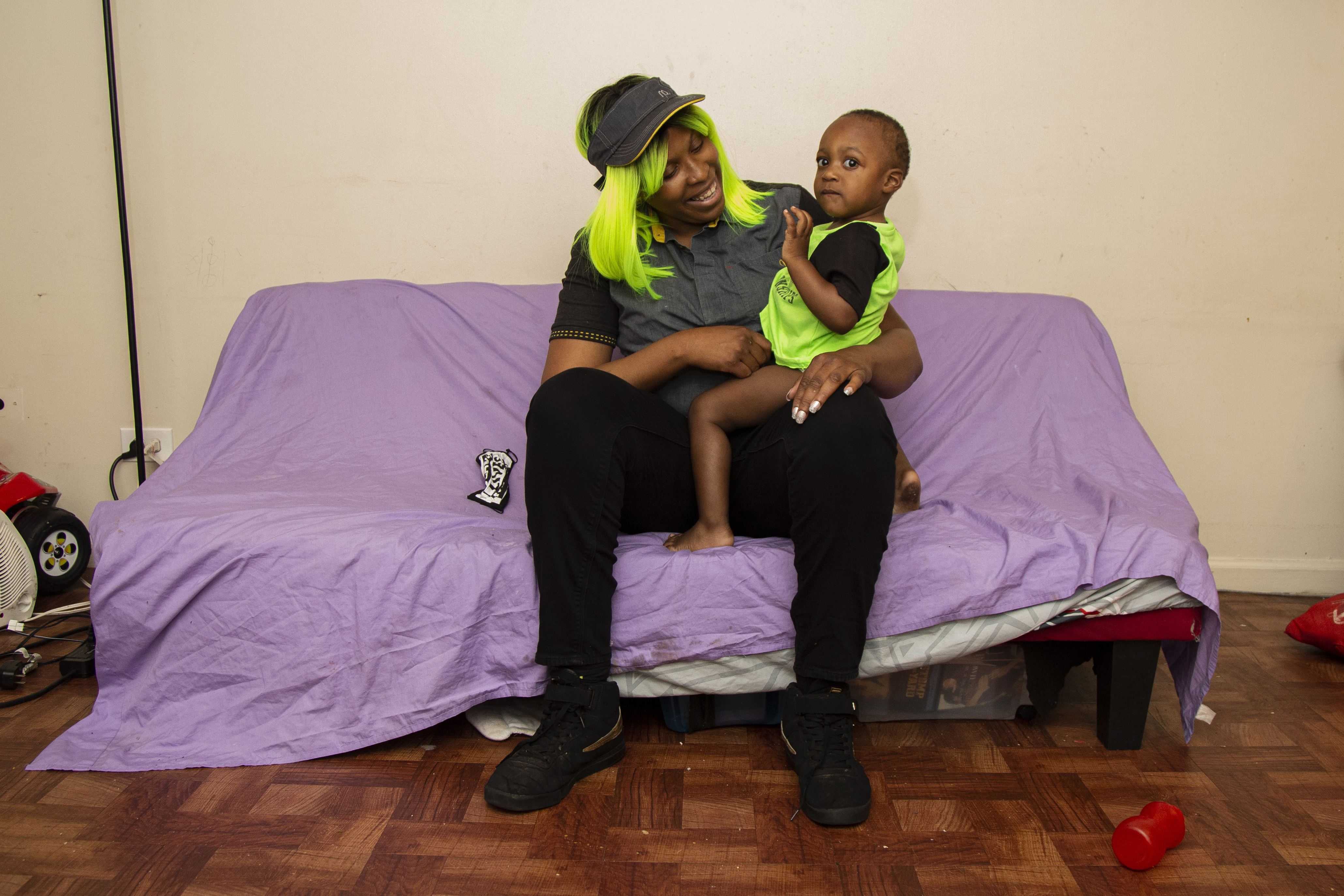 Ieshia Townsend plays with her son Demarihon Johnson at their home in South Chicago.