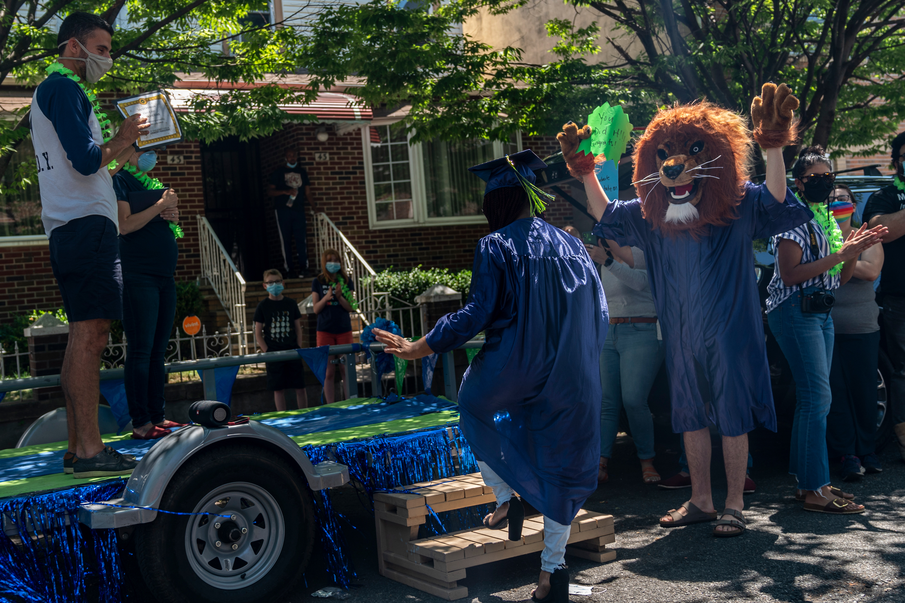 """Tashani Kerr, 18, approaches the UASEM graduation float, June 25, 2020. """"My mother told me she's proud to have me as a daughter,"""" said Kerr. """"I'm young but I've already achieved something a lot of people in my family never got the chance too."""" This fall she will start her first term as a biology major at Ithaca College. Kerr plans on becoming a Radiologist after college."""