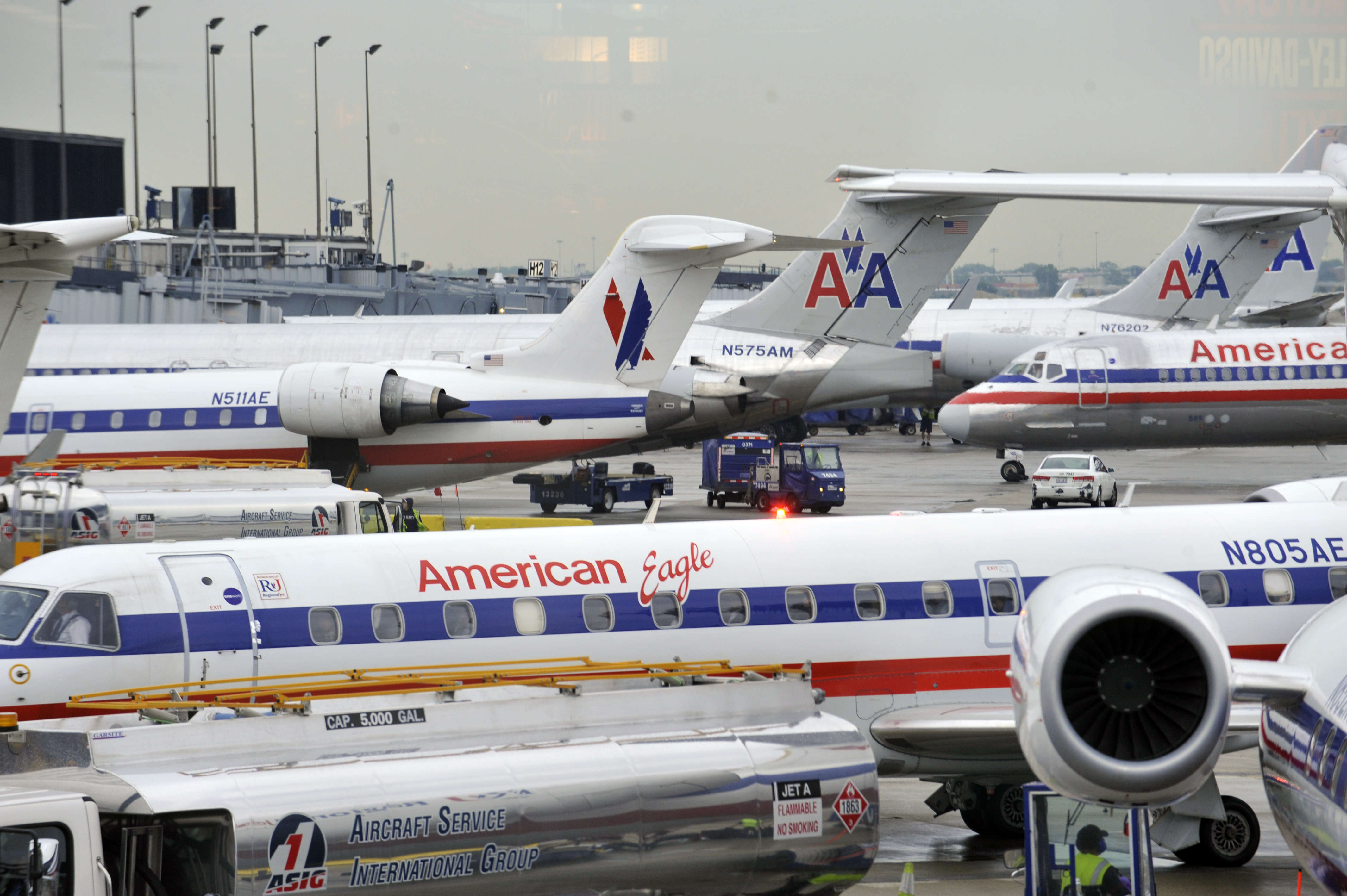 """Travel analyst Henry Harteveldt said American Airlines """"is clearly putting its profitability ahead"""" of the health of passengers and its own employees. American Airlines planes are seen here at O'Hare Airport."""
