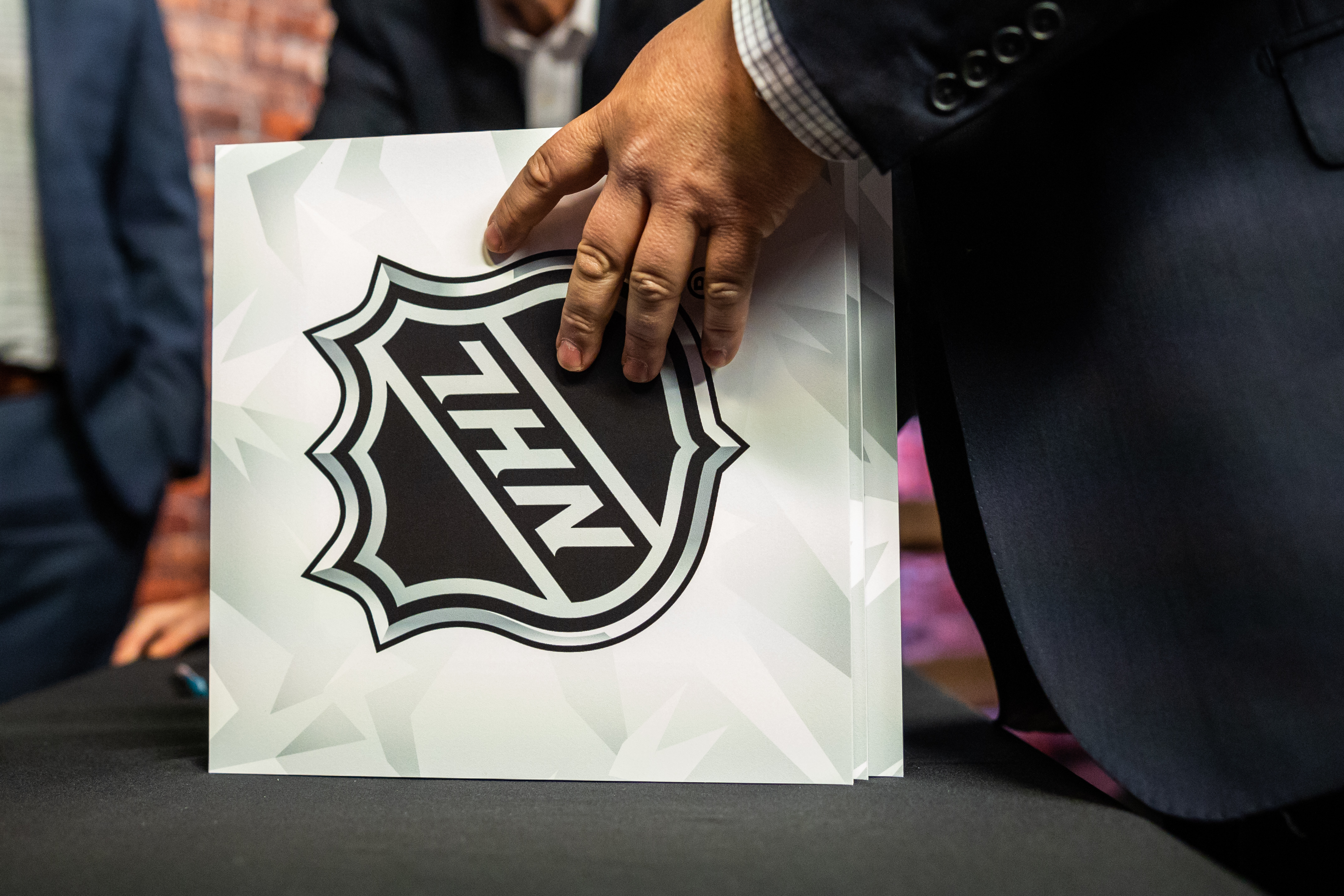 TORONTO, ON - APRIL 10: An NHL official stacks the cards during The National Hockey League Draft Lotteryat the CBC Studios on April 10, 2019 in Toronto, Ontario, Canada.