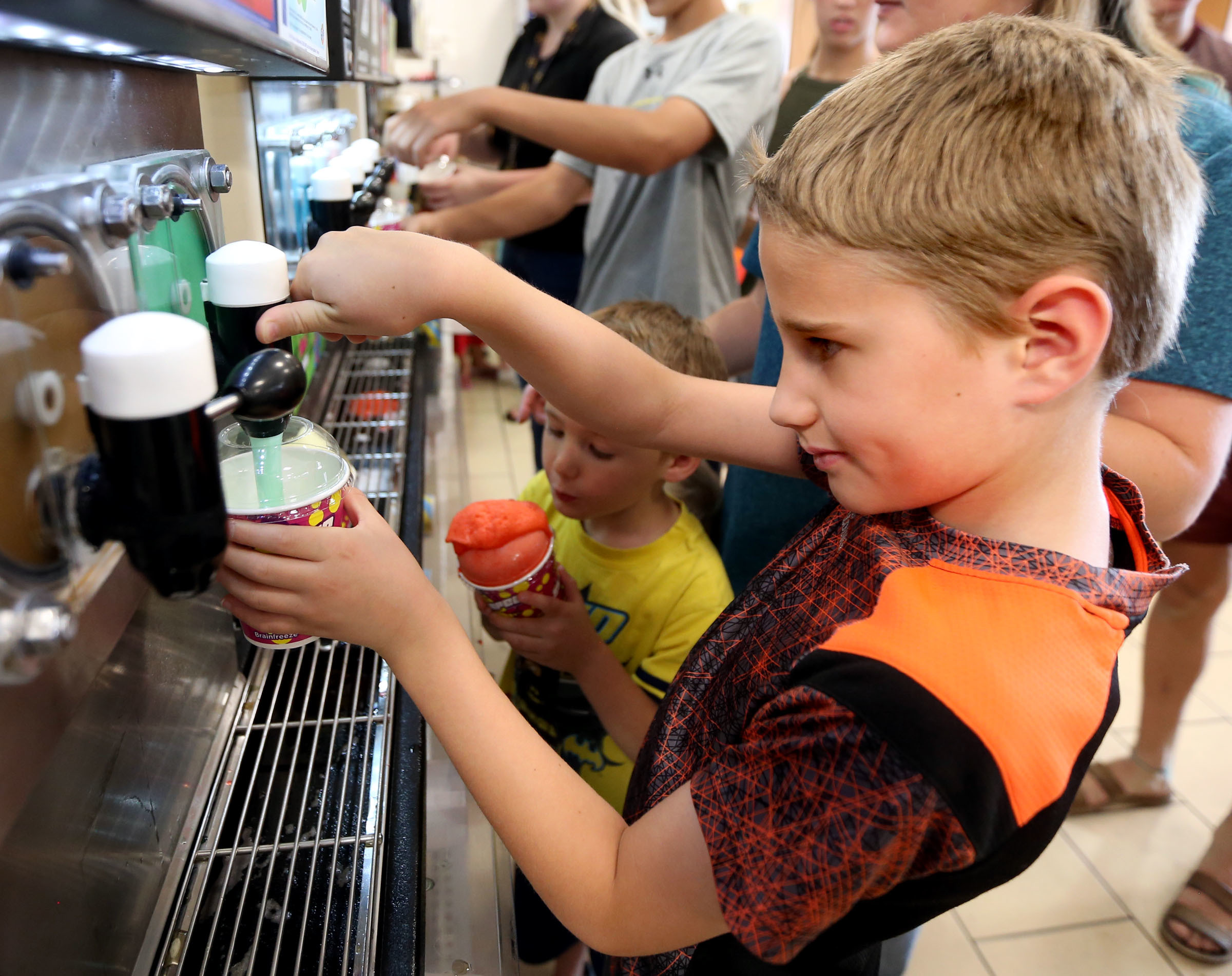 Levi Jordan gets his free Slurpee during 7-Eleven Day at 7-Eleven in Lehi on Tuesday, July 11, 2017. This particular 7-Eleven also hosted a blood drive with the Red Cross for 7-Eleven Day.