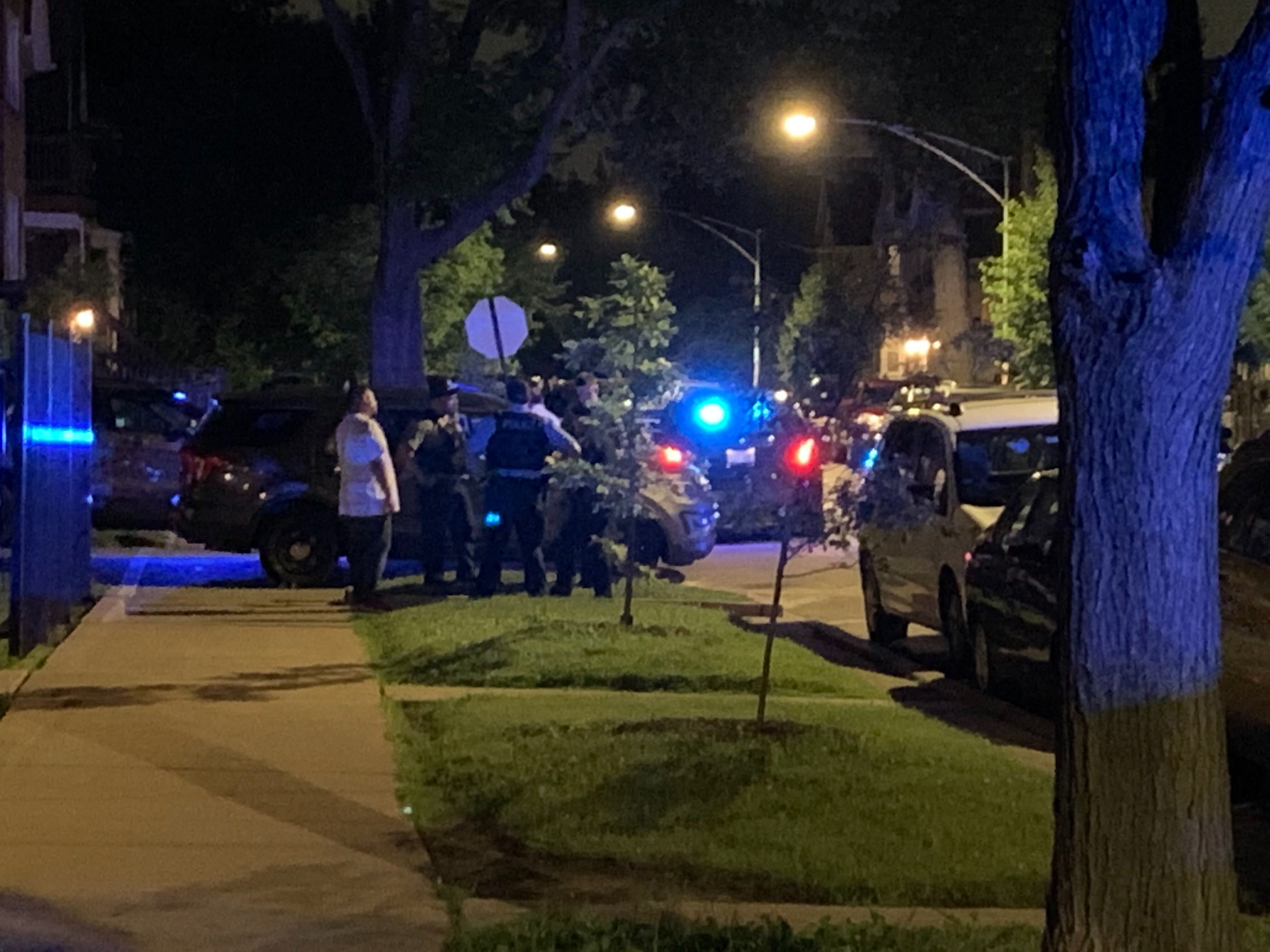 Chicago police investigate Saturday in the 3500 block of West Dickens Avenue where a 10-year-old girl was struck by a stray bullet that came through the window of a Logan Square apartment.