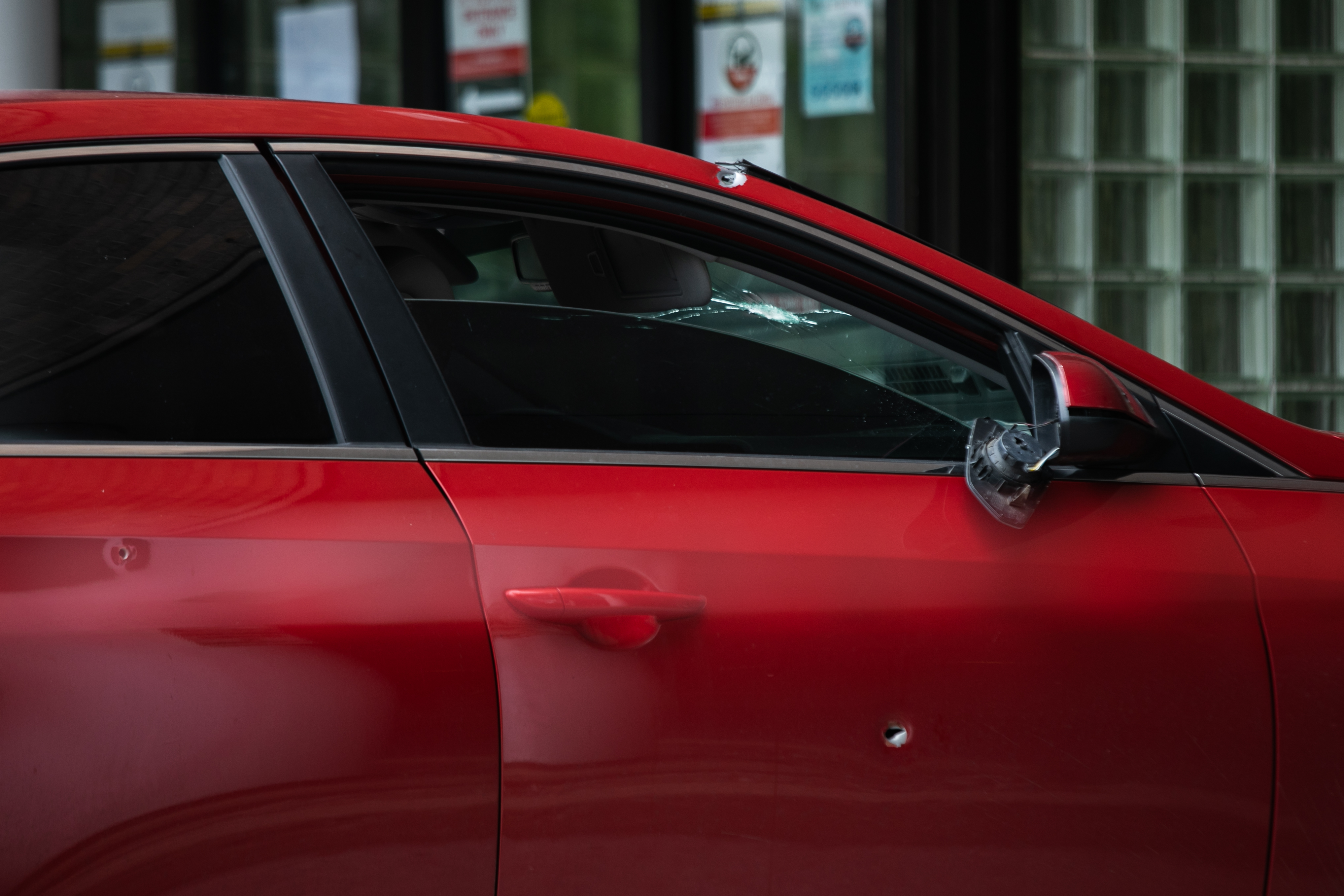 A car with bullet holes sits outside St. Bernard Hospital where a 1-year-old boy died after being shot in chest while he was riding in the car with his mother as they drove home from a laundromat Saturday afternoon in Englewood.