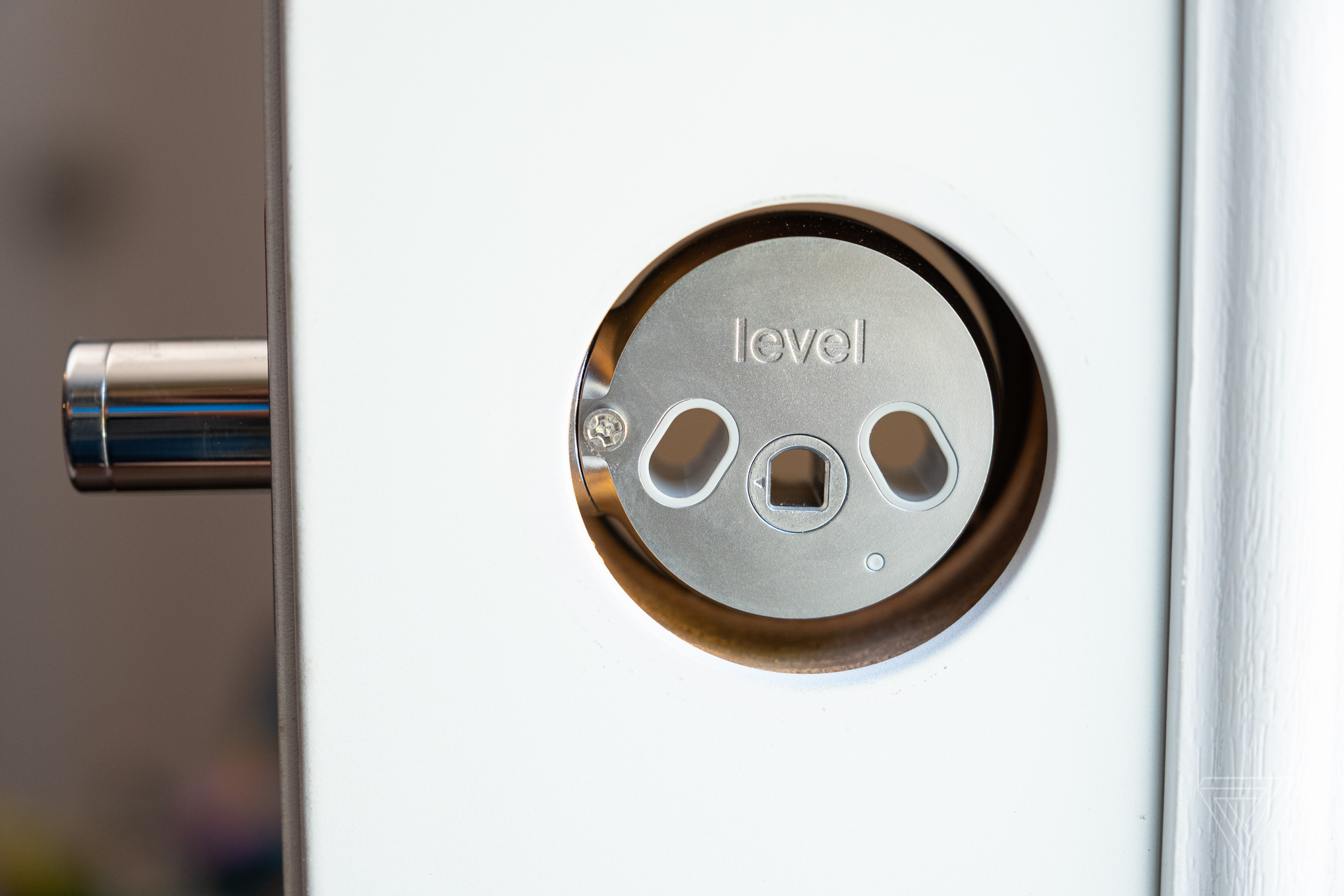 The Level Lock smart lock in a door frame