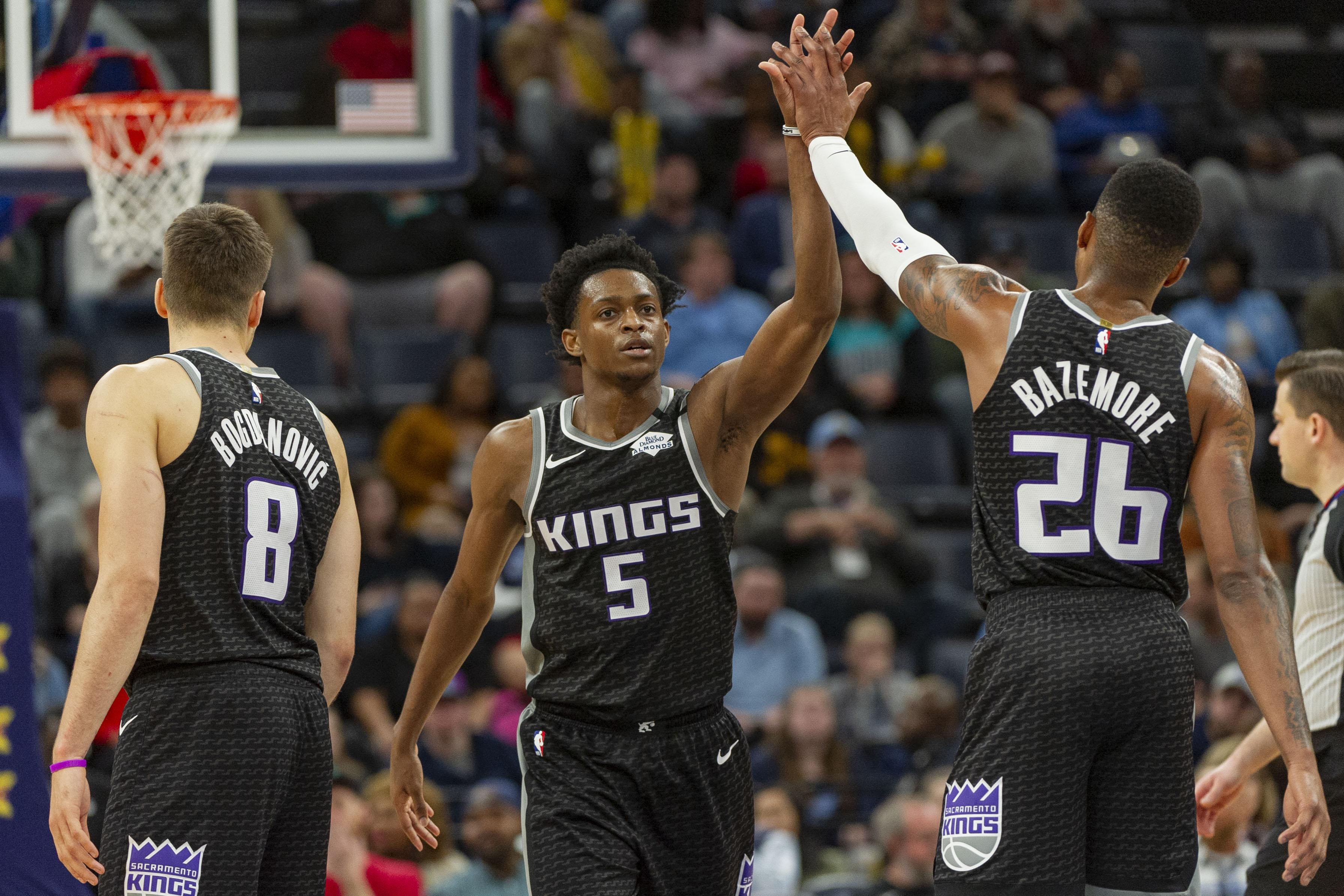 Sacramento Kings guard De'Aaron Fox and guard Kent Bazemore react during the second half against the Memphis Grizzlies at FedExForum.