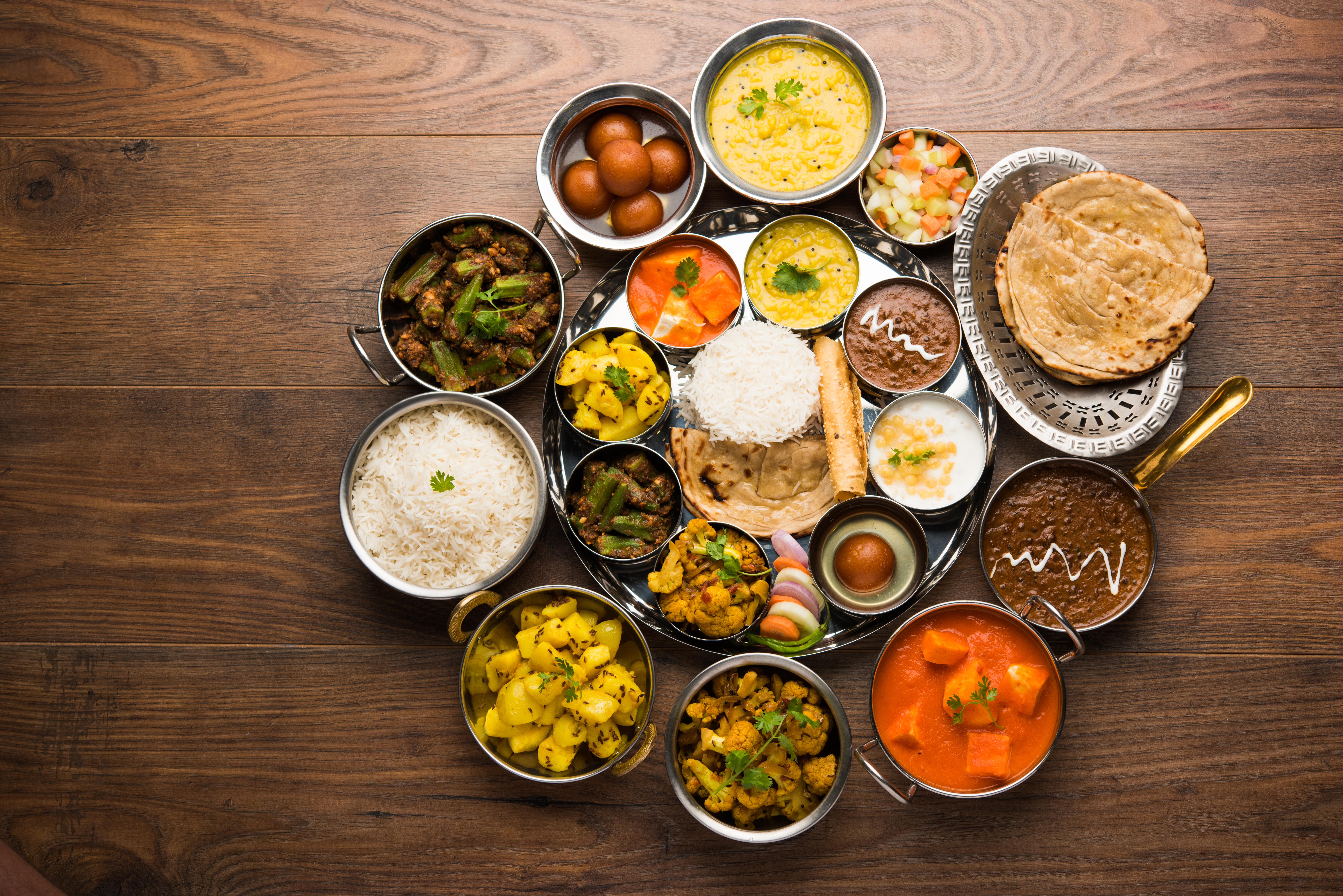 An Indian thali, an assortment of rice, flatbreads, and prepared dishes arranged on a table