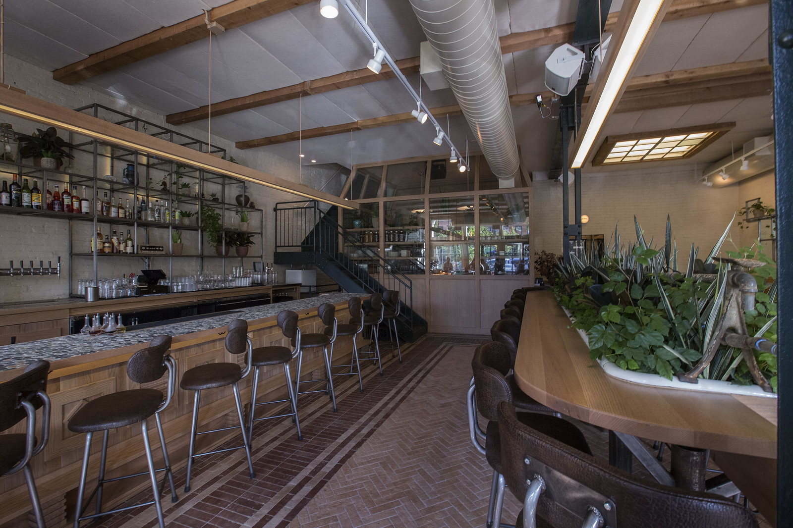 A lush bar with plenty of plants.