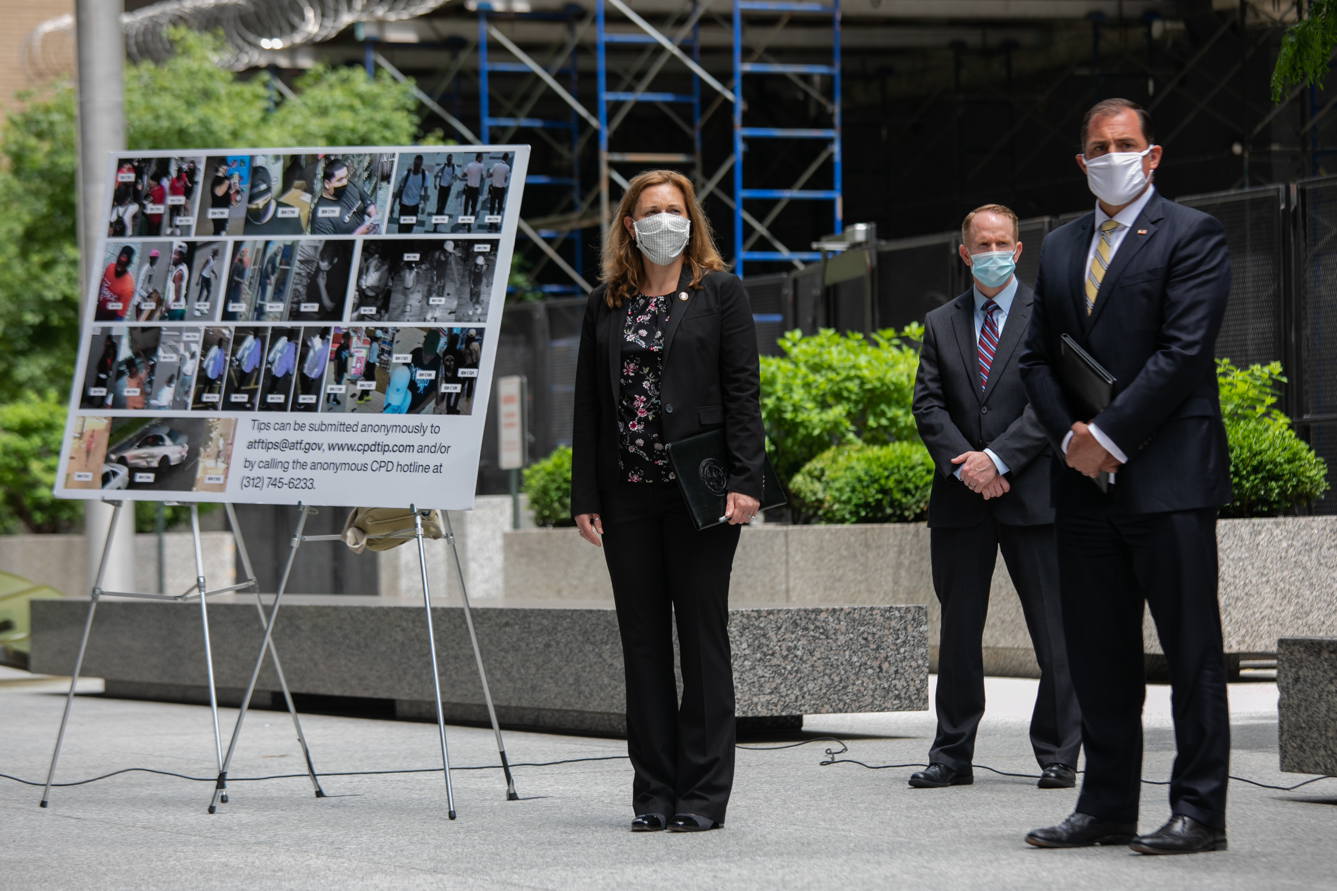 Kristen deTineo, special agent in charge of the Bureau of Alcohol, Tobacco, Firearms and Explosives and U.S. Attorney John R. Lausch, Jr., right, at a news conference outside the Dirksen Federal Building on Tuesday.