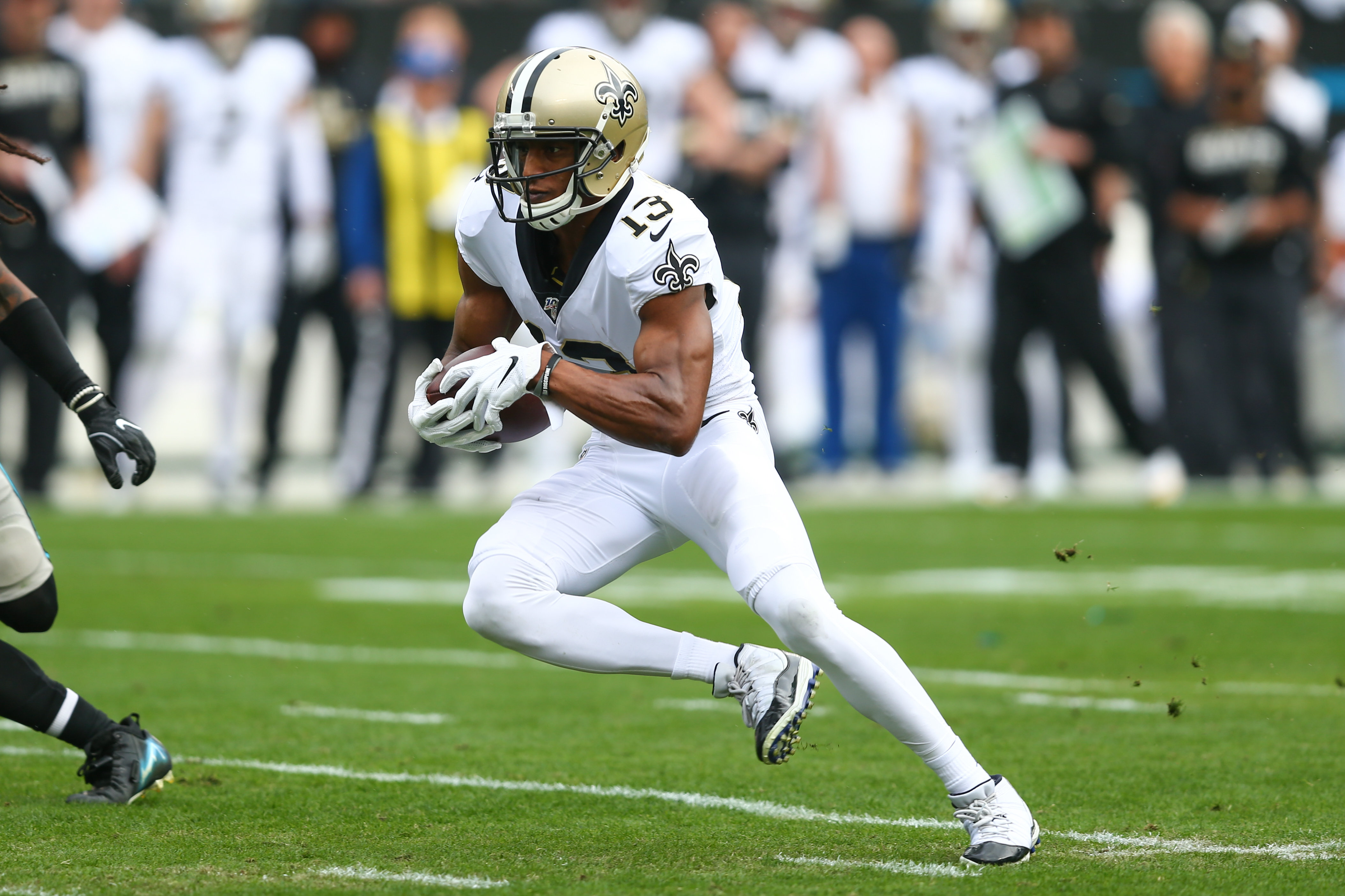 Saints wide receiver Michael Thomas runs after a reception in the first quarter against the Carolina Panthers at Bank of America Stadium.