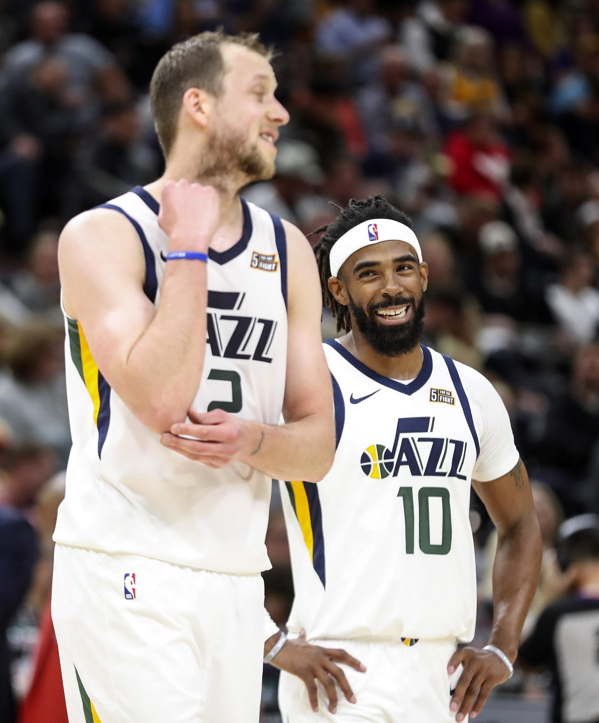 Utah Jazz guard Mike Conley (10), right, laughs with Utah Jazz forward Joe Ingles (2) during the Utah Jazz and Sacramento Kings NBA preseason basketball game at Vivint Arena in Salt Lake City on Monday, Oct. 14, 2019.