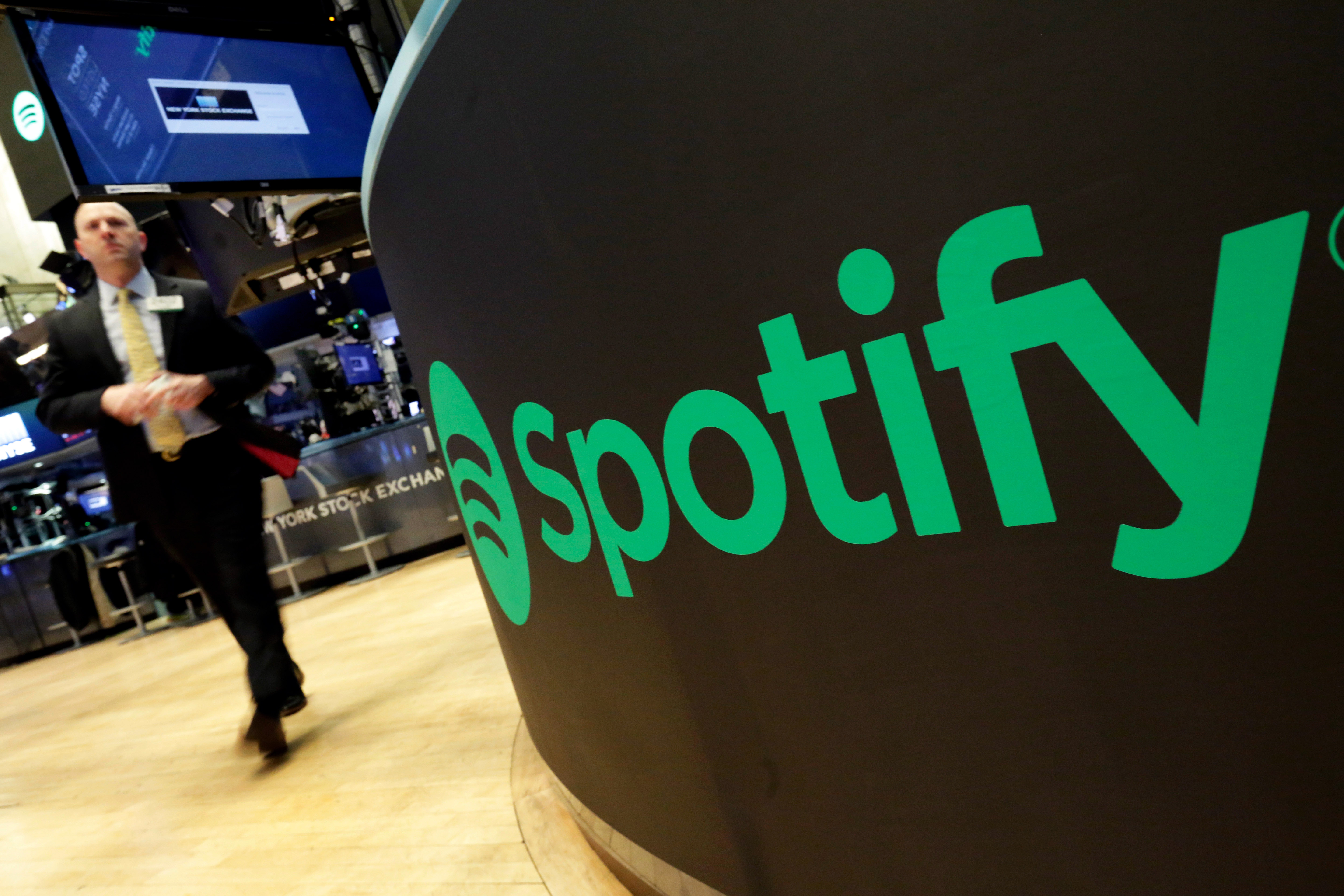 In this Tuesday, April 3, 2018 file photo, a trading post sports the Spotify logo on the floor of the New York Stock Exchange.