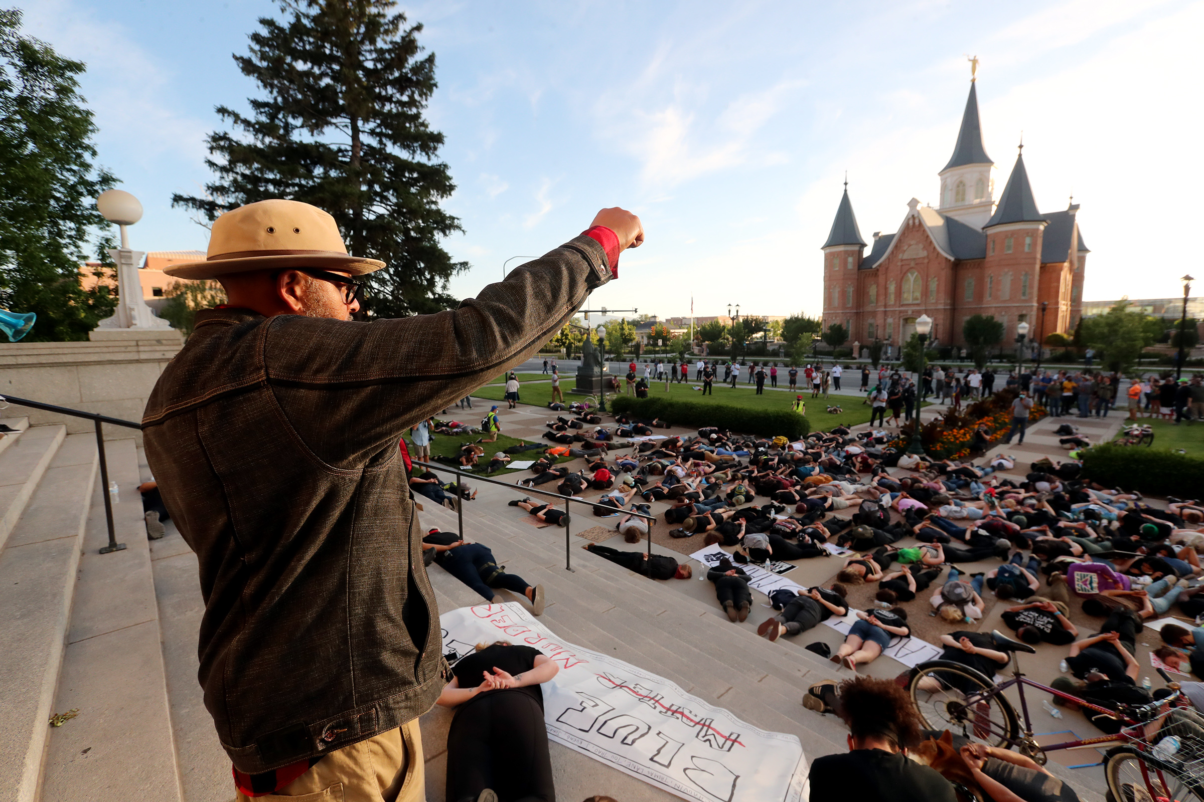 Macky, who did not provide a last name, holds his fist high for 8 minutes and 46 seconds as protesters lay down as they gather in Provo on Wednesday, July 1, 2020.