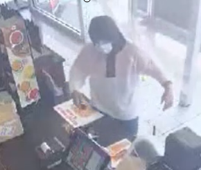 Surveillance photo of a suspect in a June 24, 2020, armed robbery at a store in the 6300 block of West North Avenue.