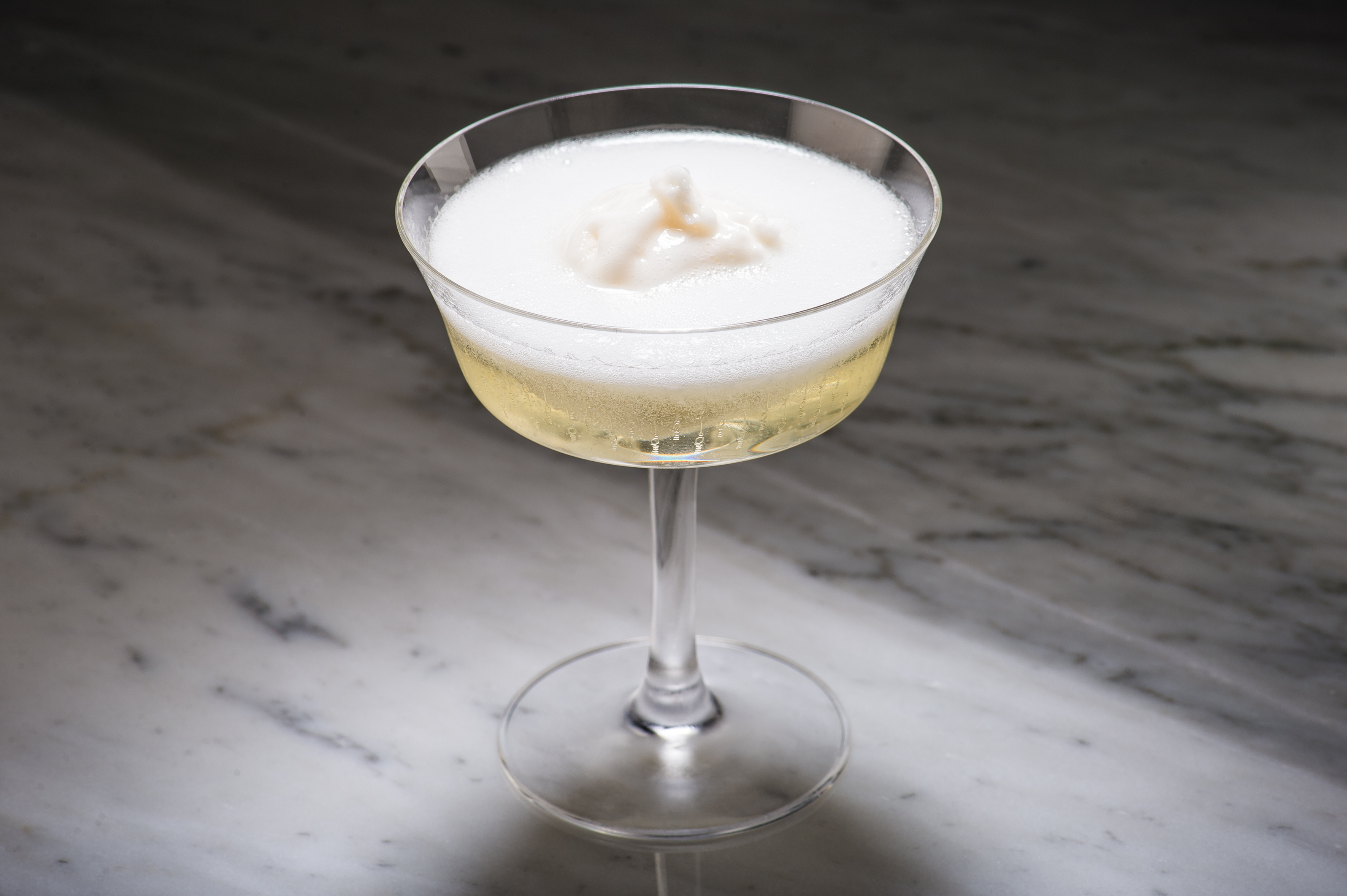 A sgroppino cocktail at Swift Shoreditch, served in a coupe on a marble bar