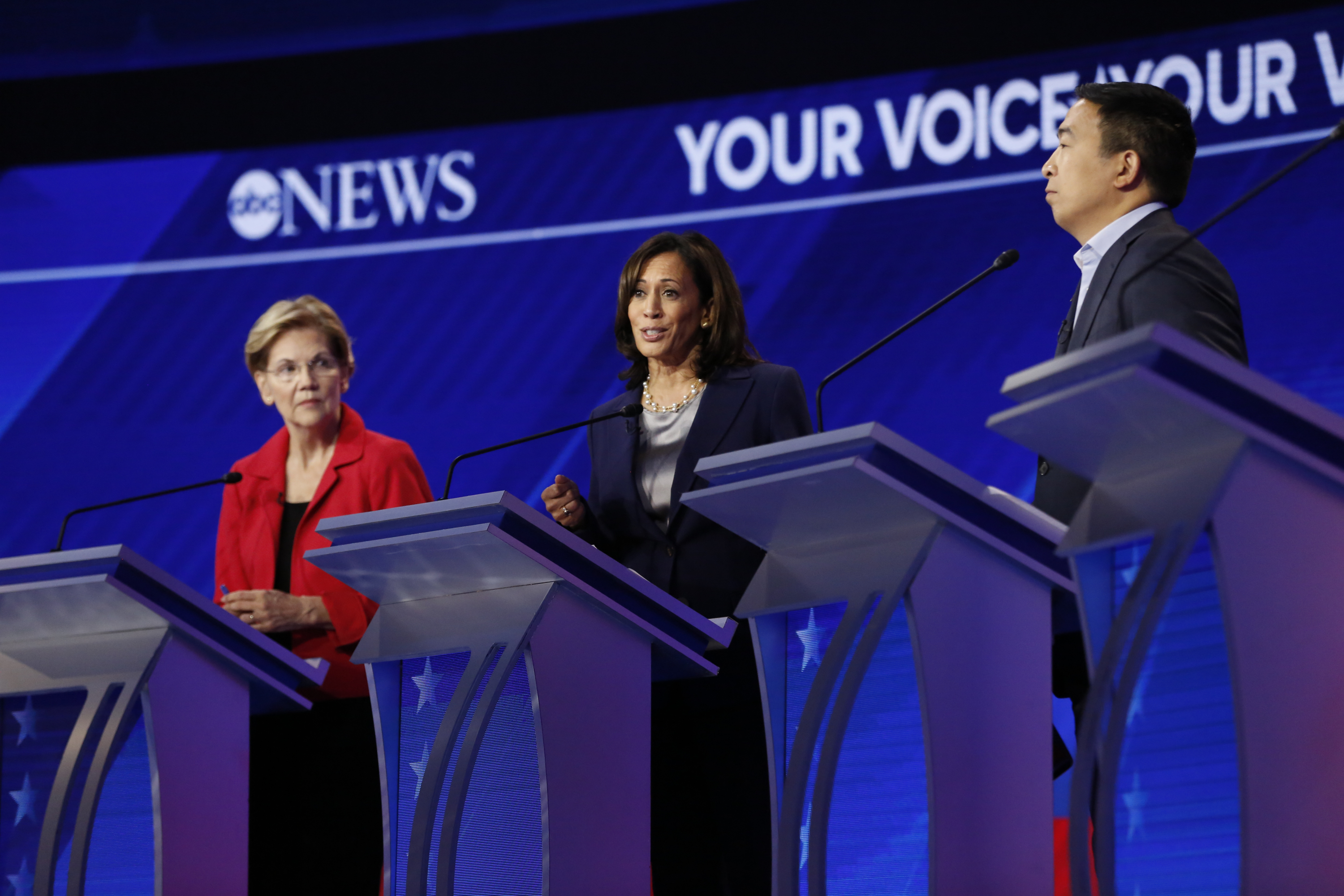 Kamala Harris, Elizabeth Warren, and Andrew Yang on stage at a 2020 Democratic presidential primary debate