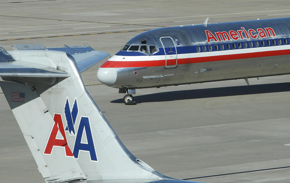 An American Airlines jet taxis at Dallas Fort Worth Airport.