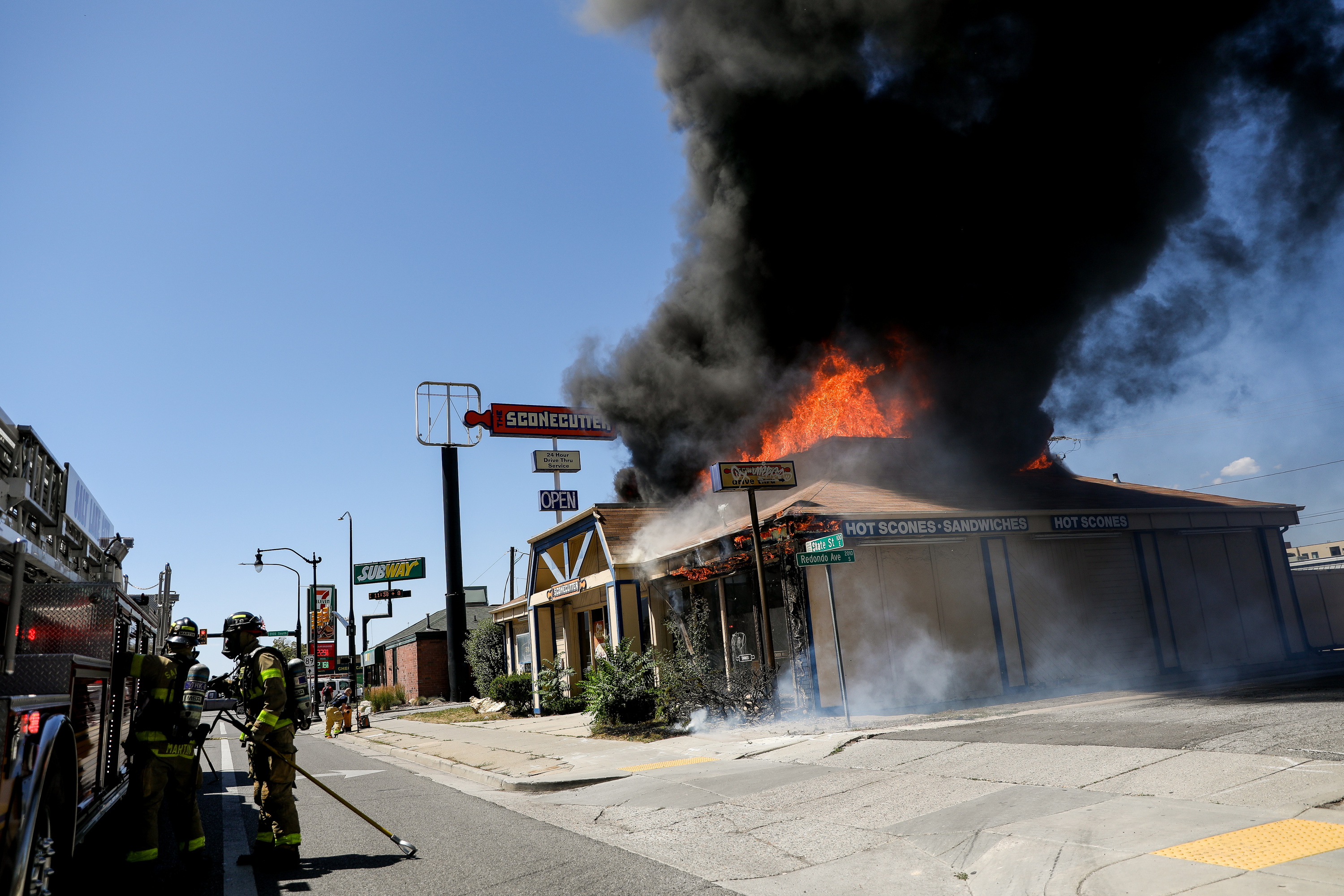 Firefighters arrive on scene as flames leap out of the roof of the old Sconecutter at 2040 S. State in Salt Lake City on Thursday, July 2, 2020. The blaze destroyed the vacant restaurant.