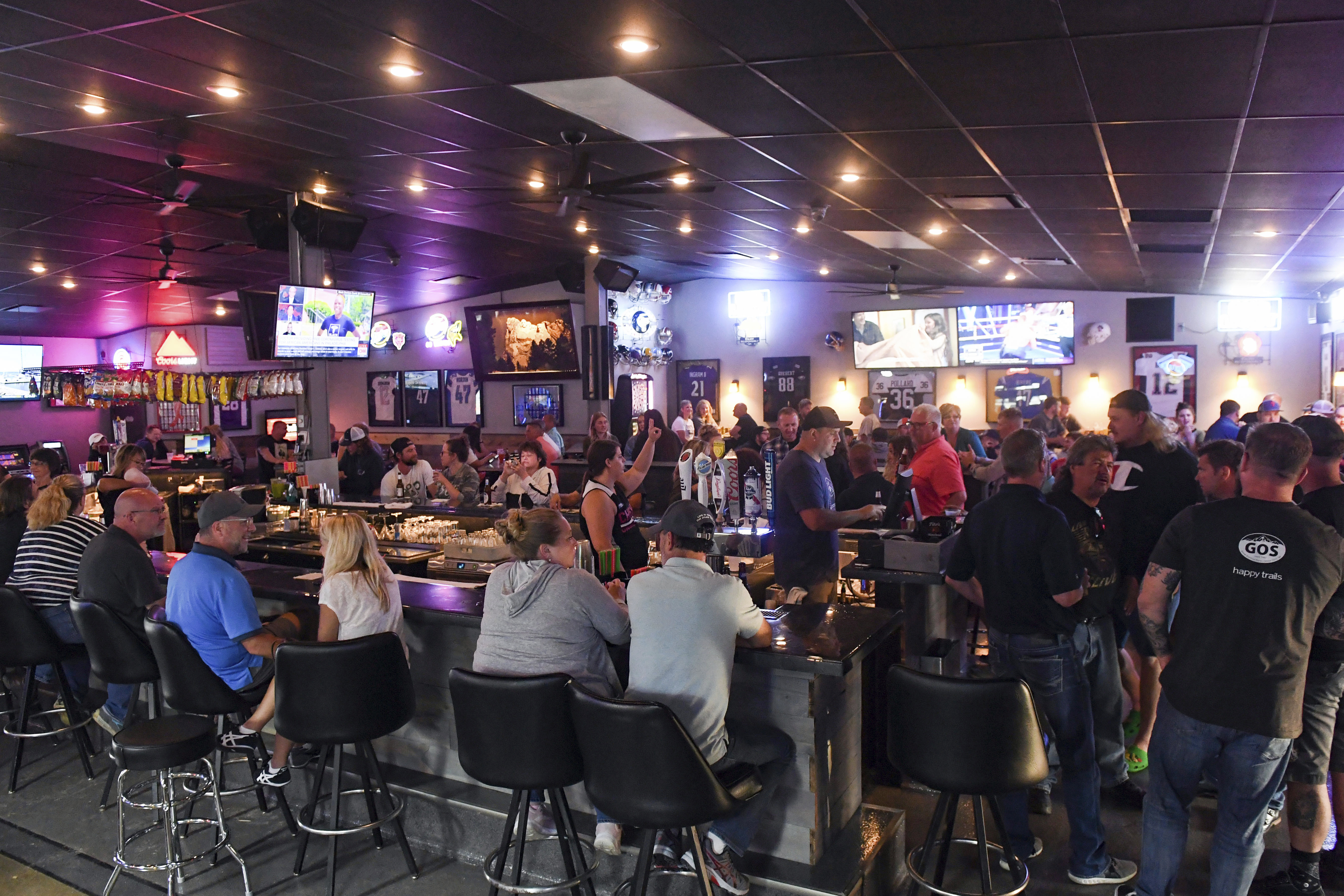 In this Thursday, June 18, 2020, file photo, patrons fill the Crow Bar in Sioux Falls, S.D. Authorities are closing honky tonks, bars and other drinking establishments in some parts of the U.S. to stem the surge of COVID-19 infections — a move backed by sound science about risk factors that go beyond wearing or not wearing masks.