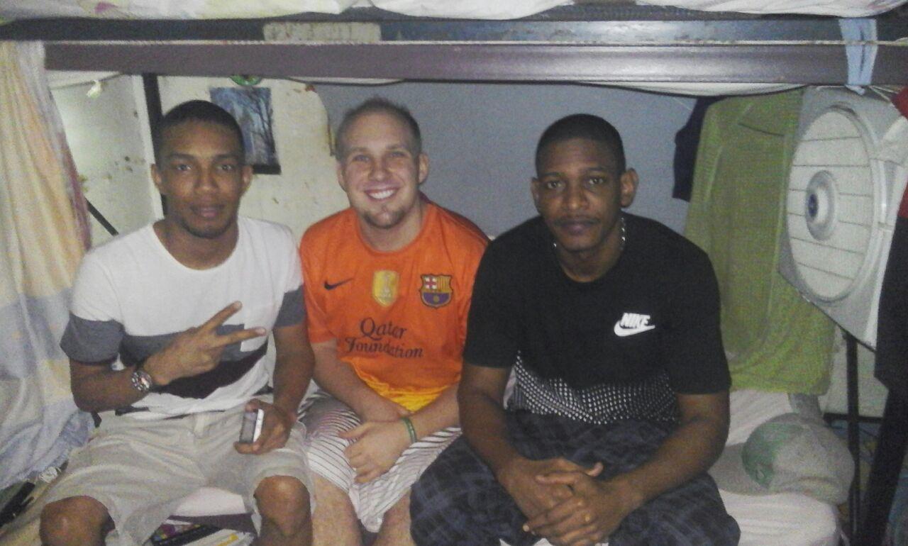 In this undated photo, cellmates El Buñuelo (Claudio Giovanni Jimenez Gomez), left, Joshua Holt, center, and Colombia at El Helicoide in Caraca, Venezuela.