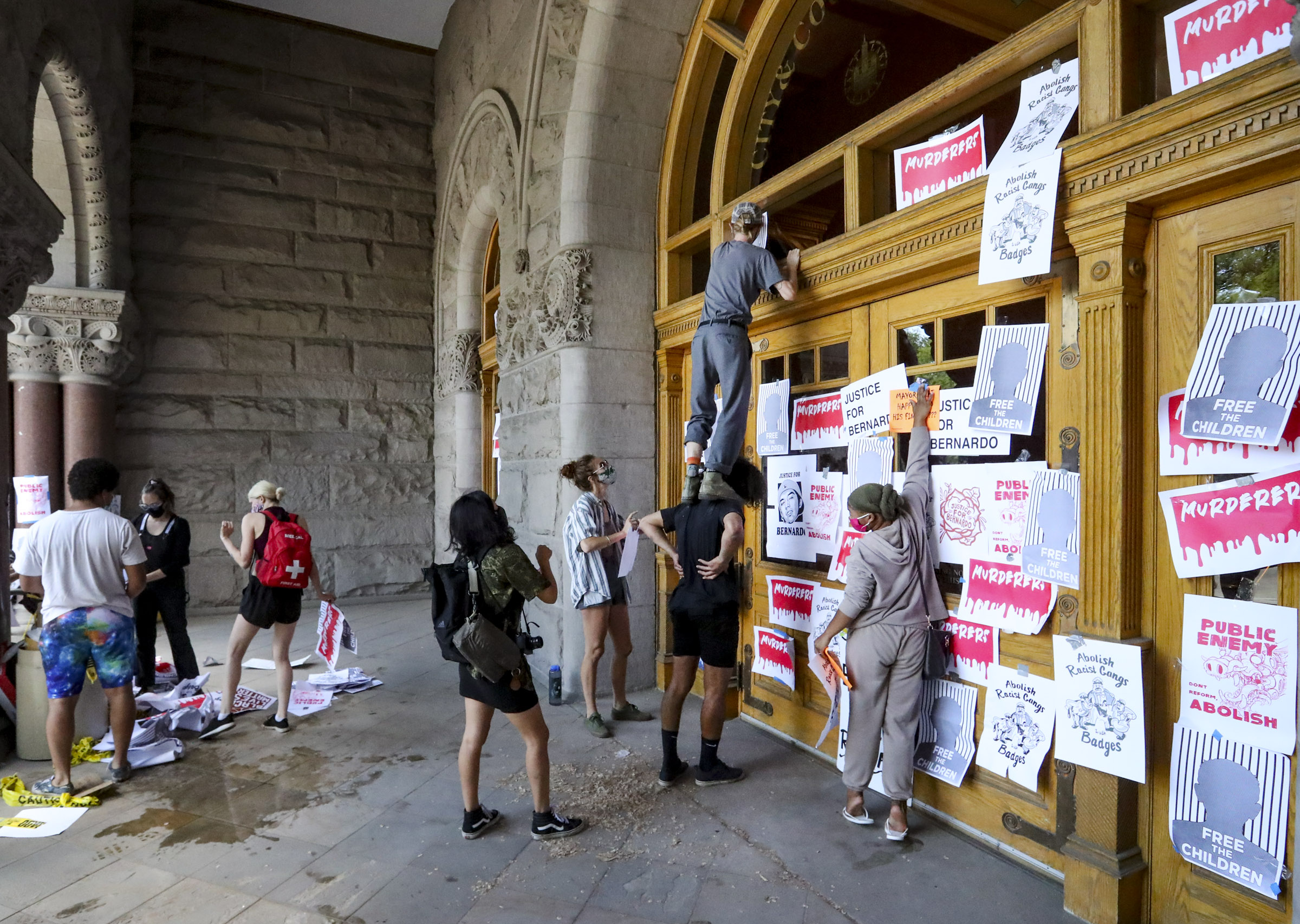 Demonstrators put signs on the Salt Lake City-County Building, on Thursday, July 2, 2020, during the latest protest decrying the death of Bernardo Palacios-Carbajal, who was shot and killed by police in May. The protest was cut short after the police made an arrest.