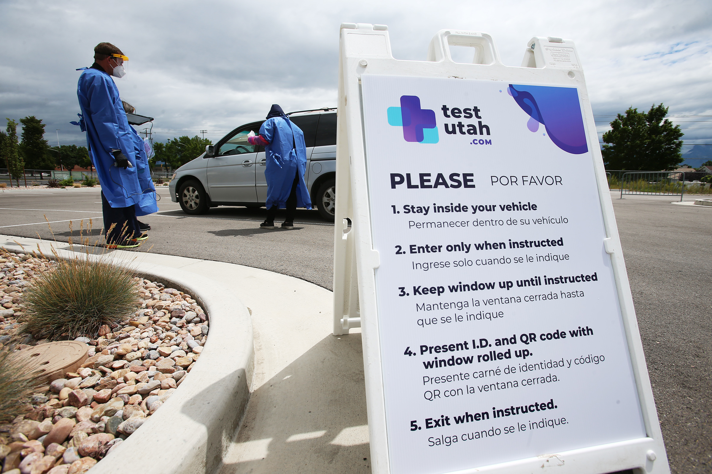 TestUtah workers conduct COVID-19 testing at a site near the Utah Olympic Oval in Kearns on Tuesday, June 30, 2020.