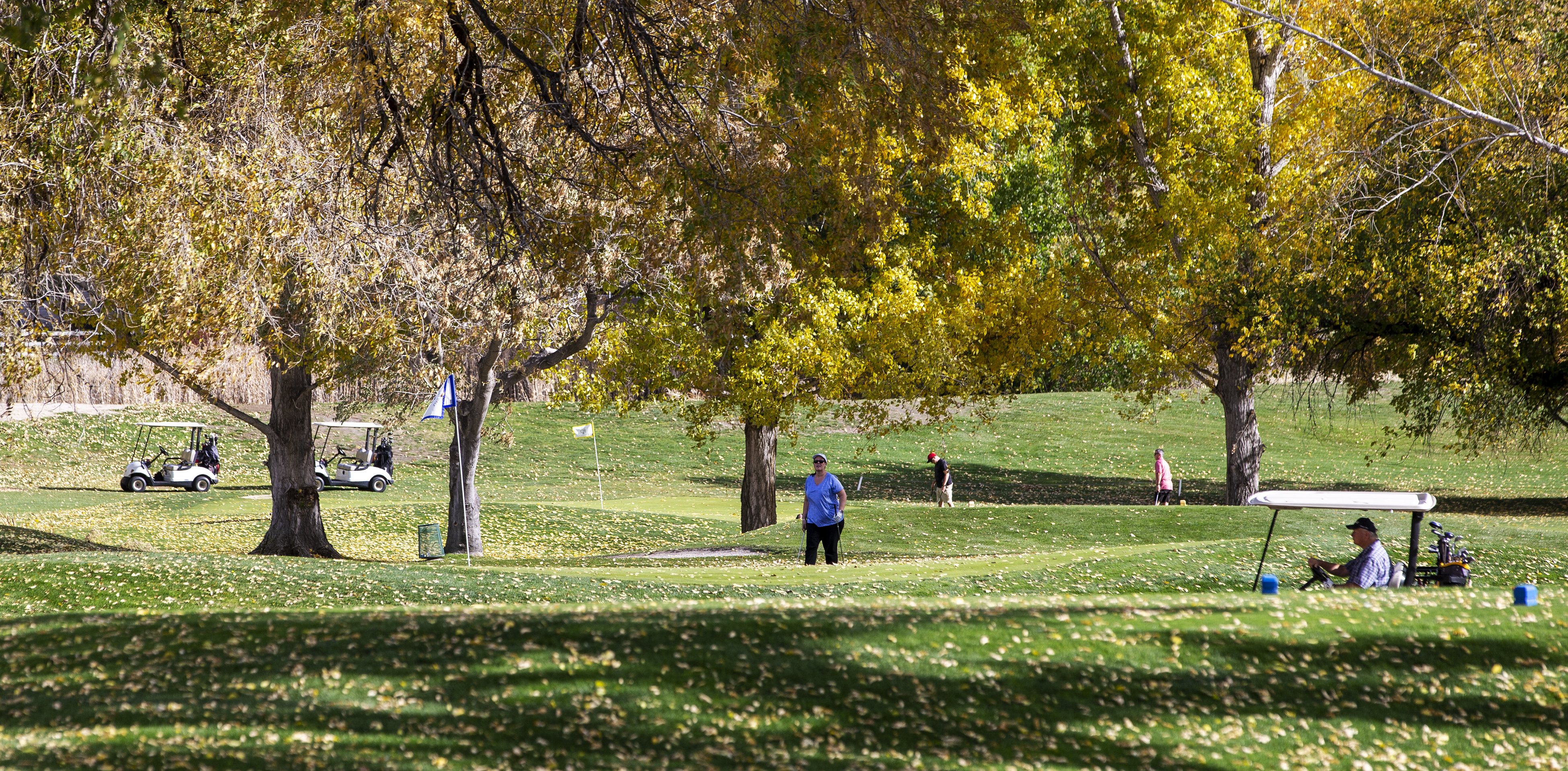 Golfers get in a few holes at Forest Dale Golf Course in Salt Lake City on Sunday, Oct. 28, 2018.