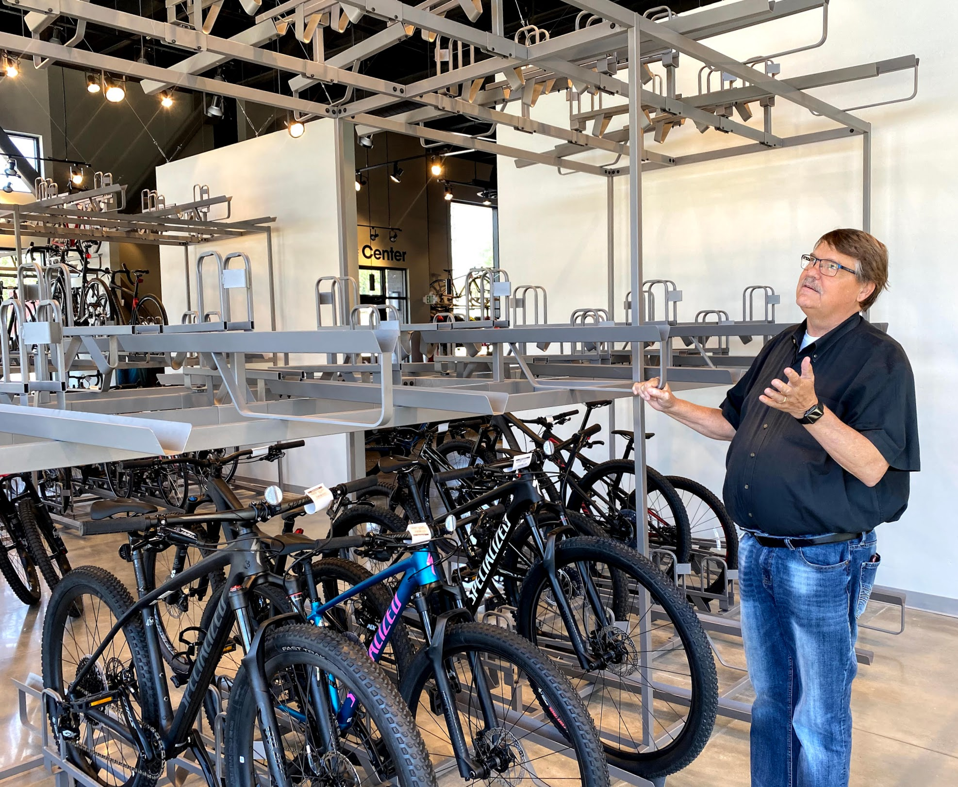 Phil Blomquist, owner of Bicycle Center in Sugar House, looks at an empty bike rack. During the pandemic, bikes are selling so fast it's hard to replenish the inventory.