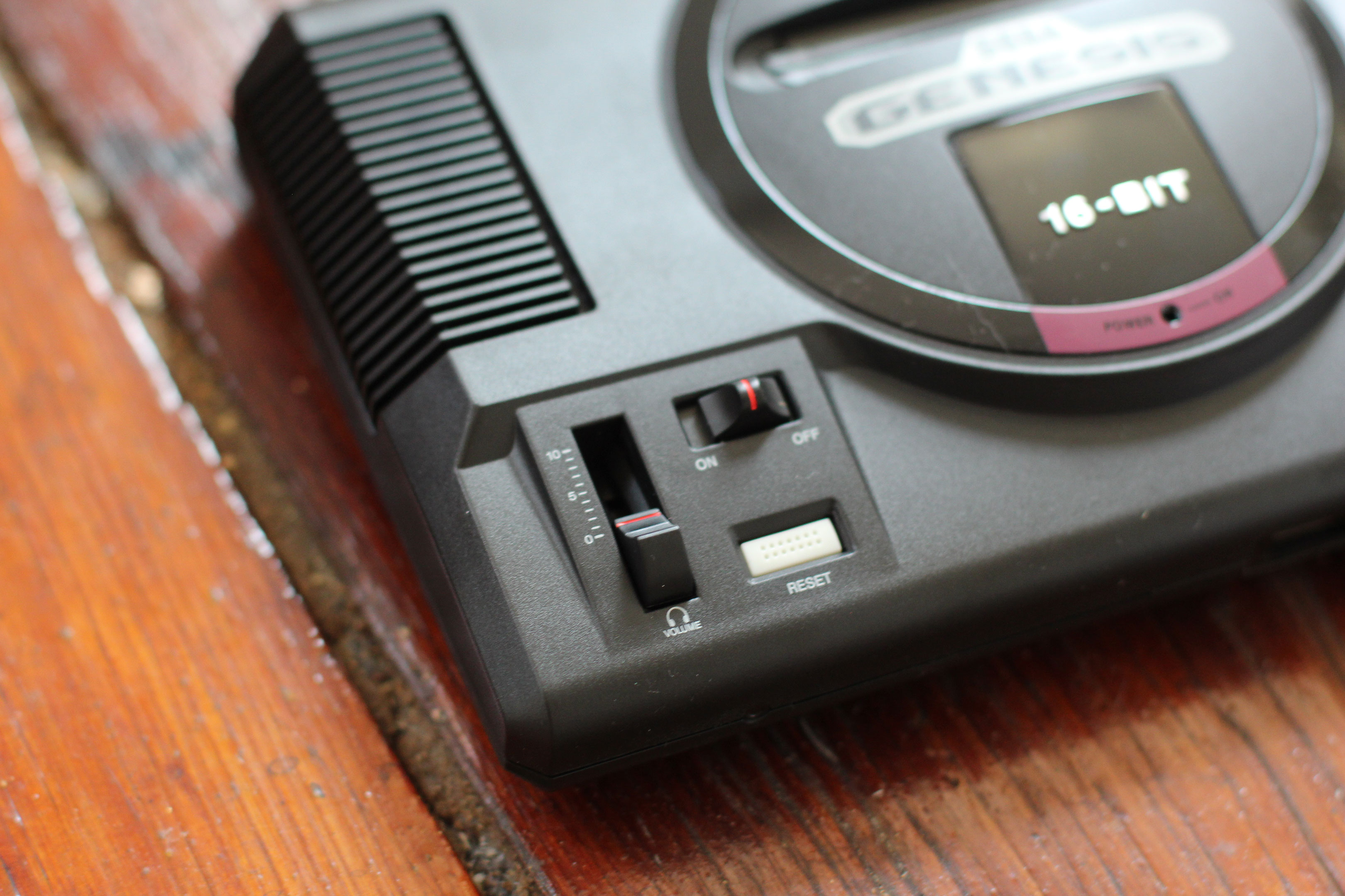 A photo of the Sega Genesis mini console on a hardwood floor.