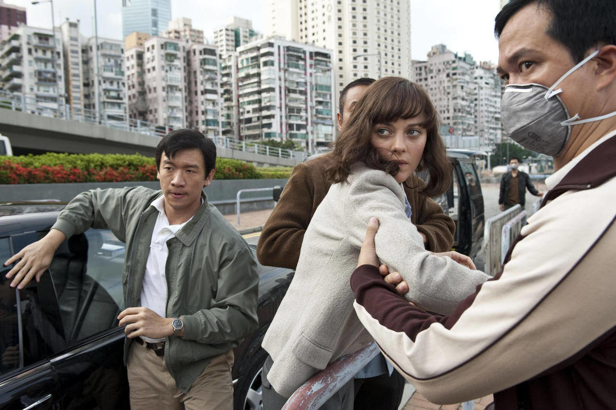 """In this image released by Warner Bros. Pictures, Chin Han, left, and Marion Cotillard are shown in a scene from the film """"Contagion."""""""