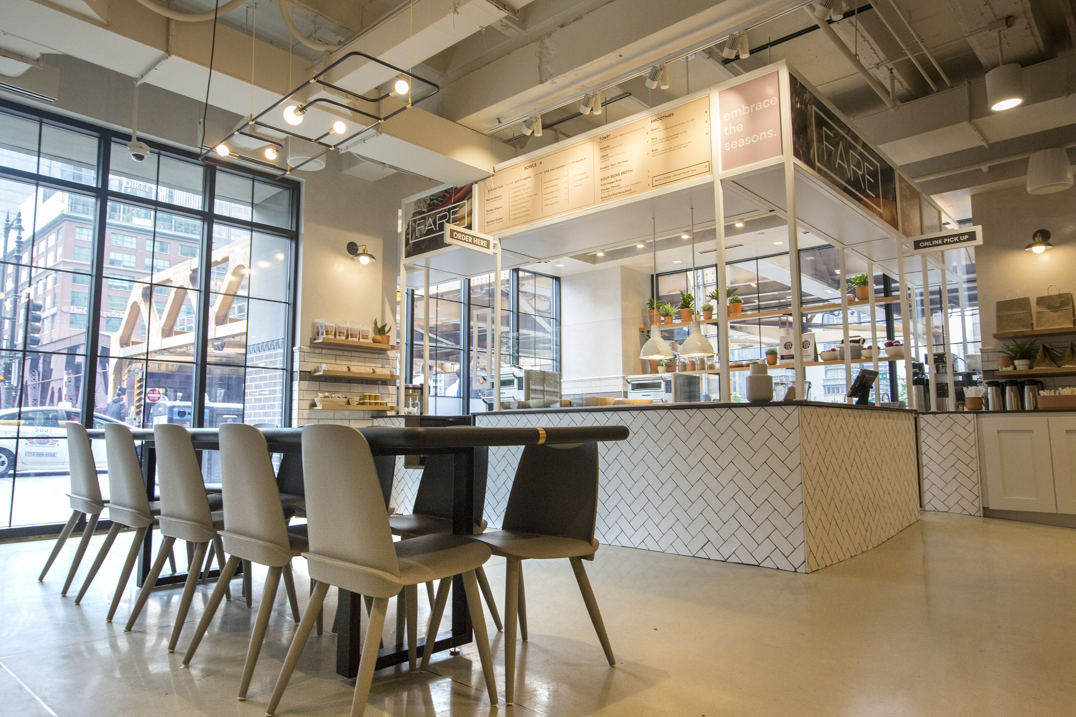 A sleek, white interior of a large food hall.