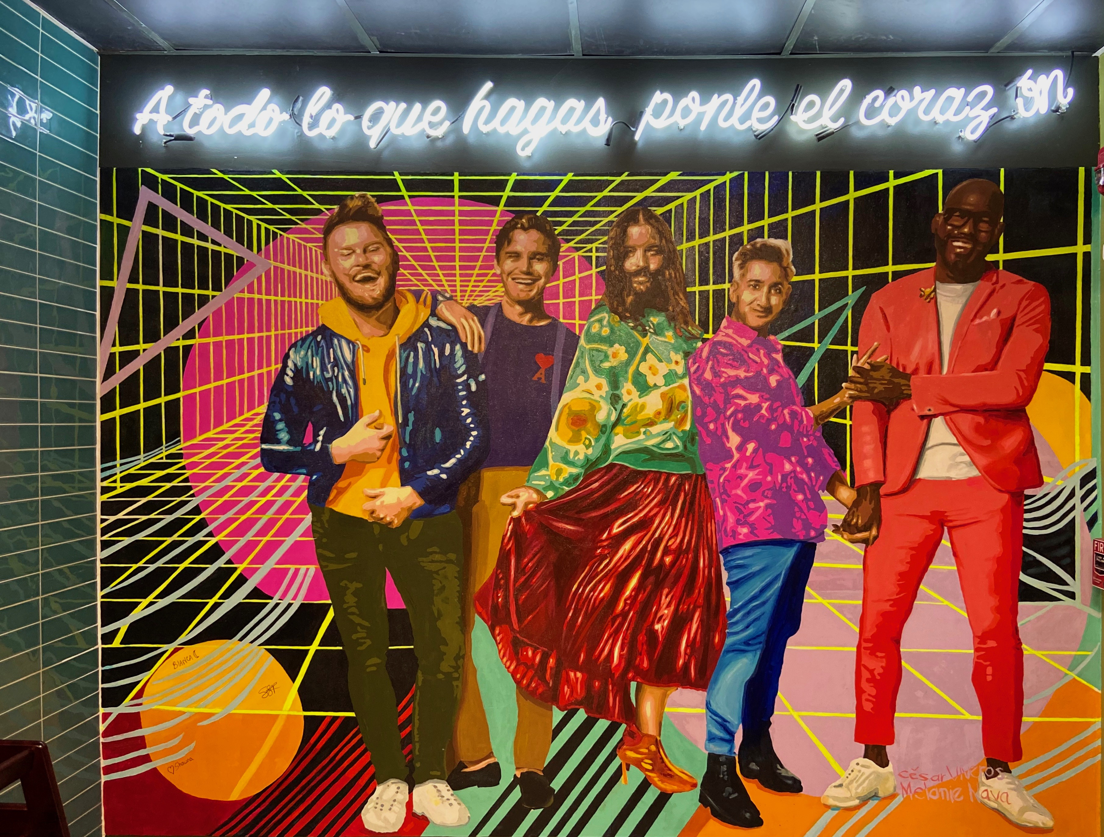 bright mural with five people under neon sign