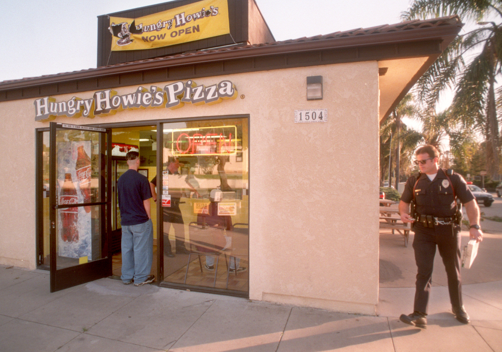 A Ventura Police officer investigates an armed robbery at Hungry Howie's Pizza on Thompson Boulevard