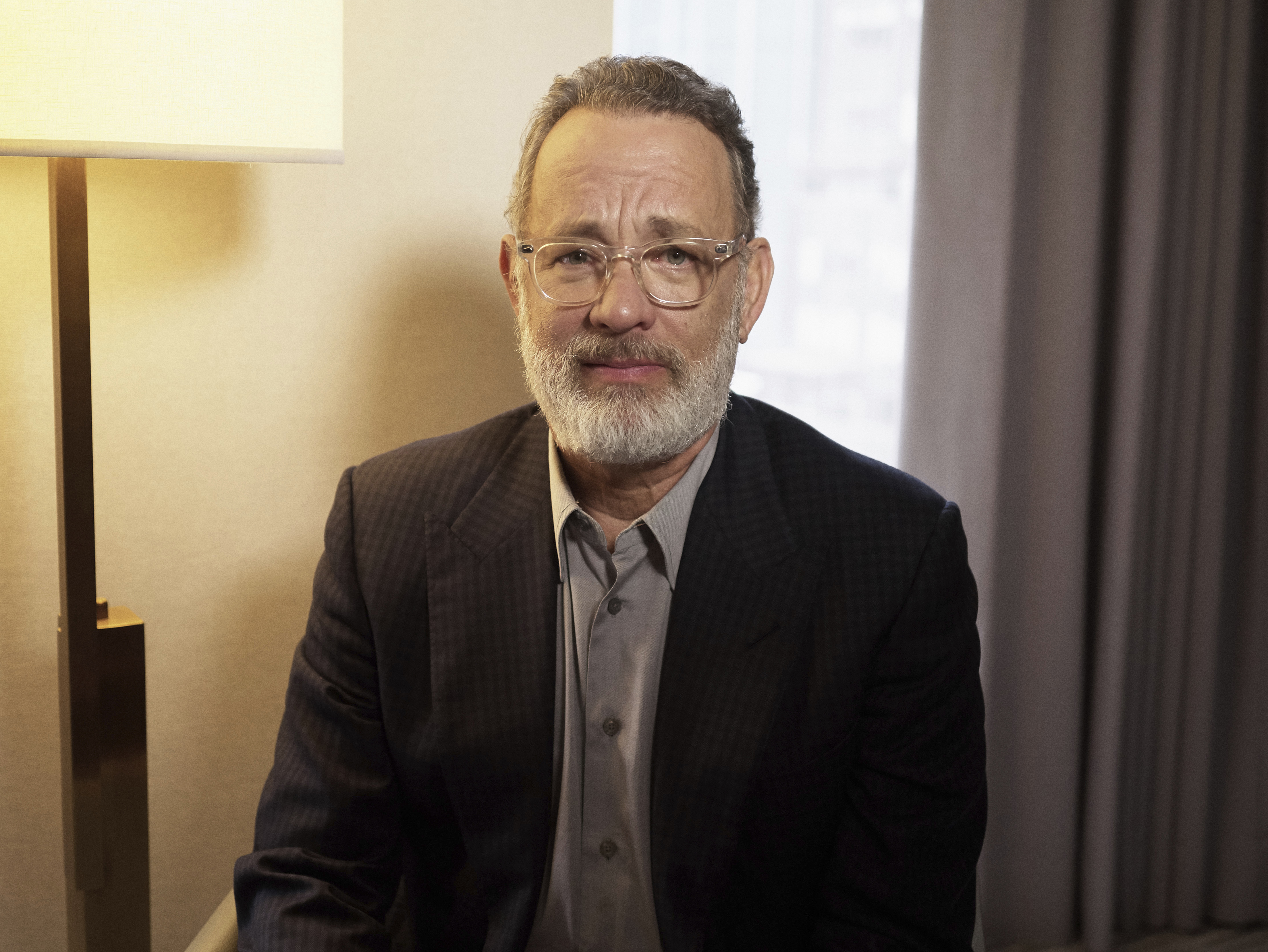 "This Nov. 17, 2019 photo shows Tom Hanks posing for a portrait in New York. Hank's latest film ""Greyhound,"" premieres this week on Apple TV Plus."