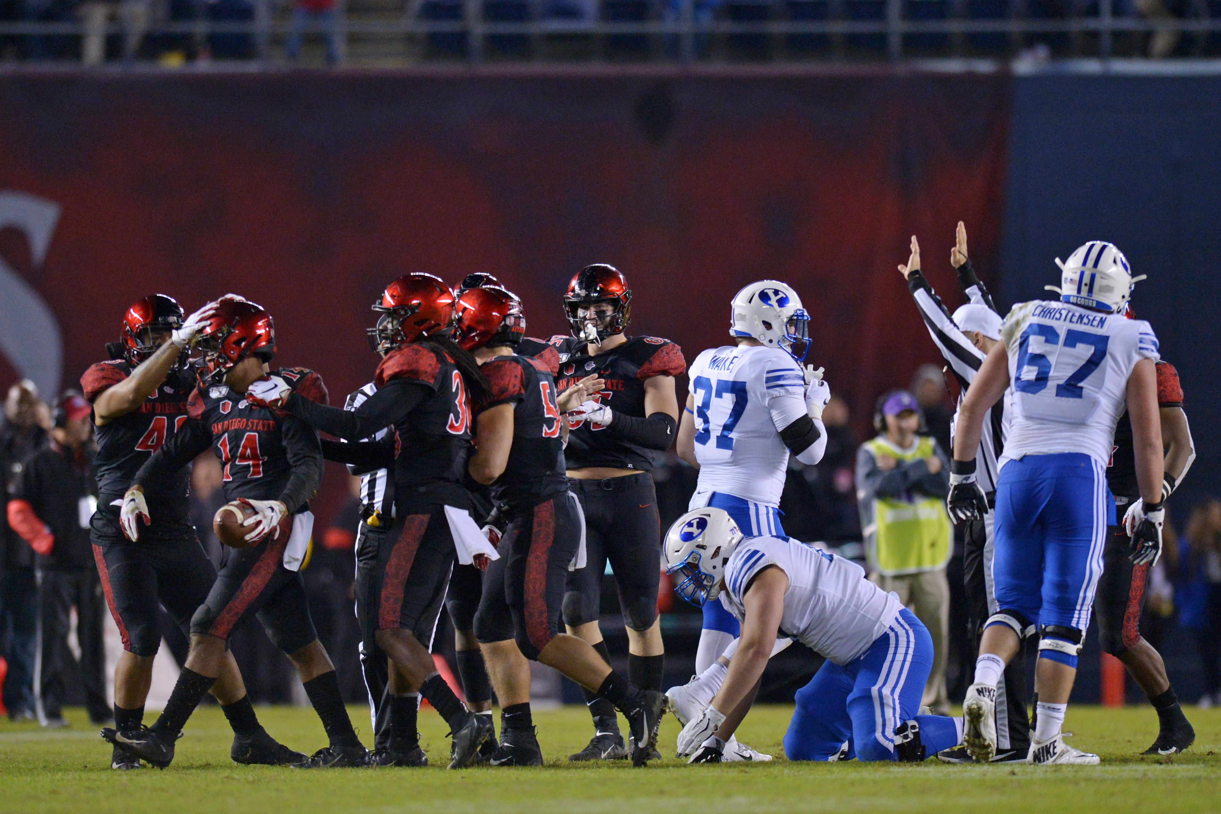 SDSU safety Tariq Thompson is congratulated after recovering a fumble against BYU.
