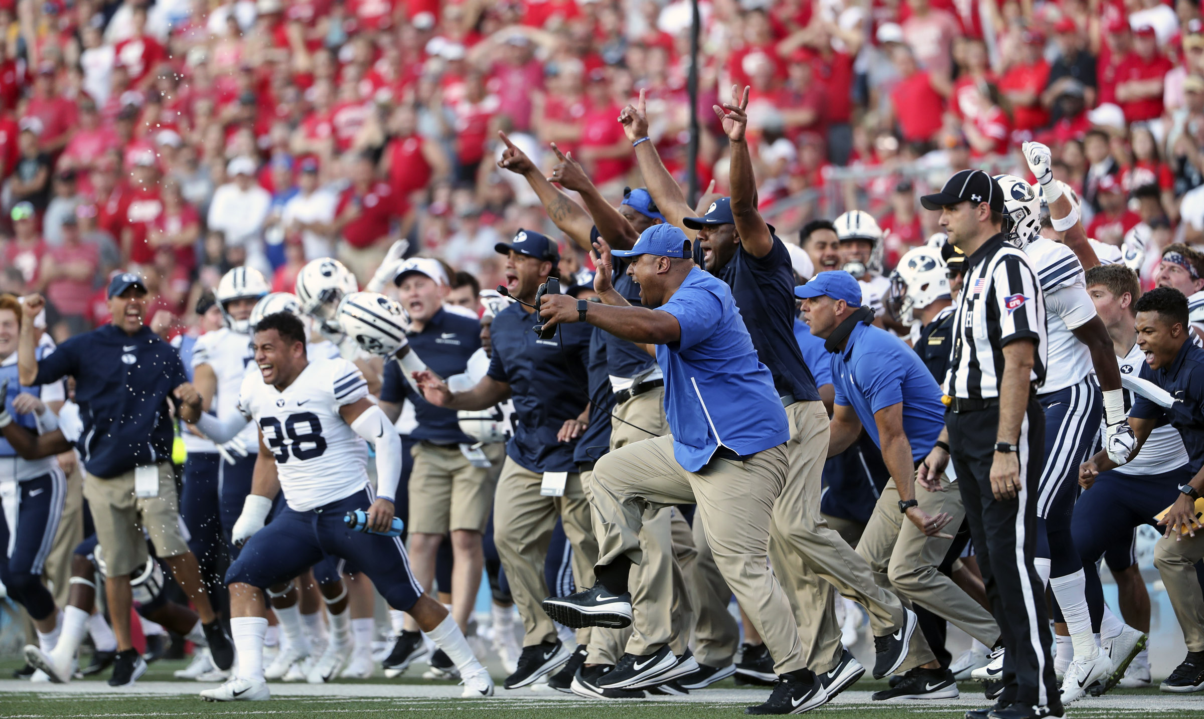 The Cougar bench explodes with excitement after a potential game-tying Wisconsin kick sailed wide during the Wisconsin-BYU football game at Camp Randall Stadium in Madison, Wisconsin, on Saturday, Sept. 15, 2018. BYU is still on the outside looking in on Power Five, but have a long history of competing against Power Five schools.