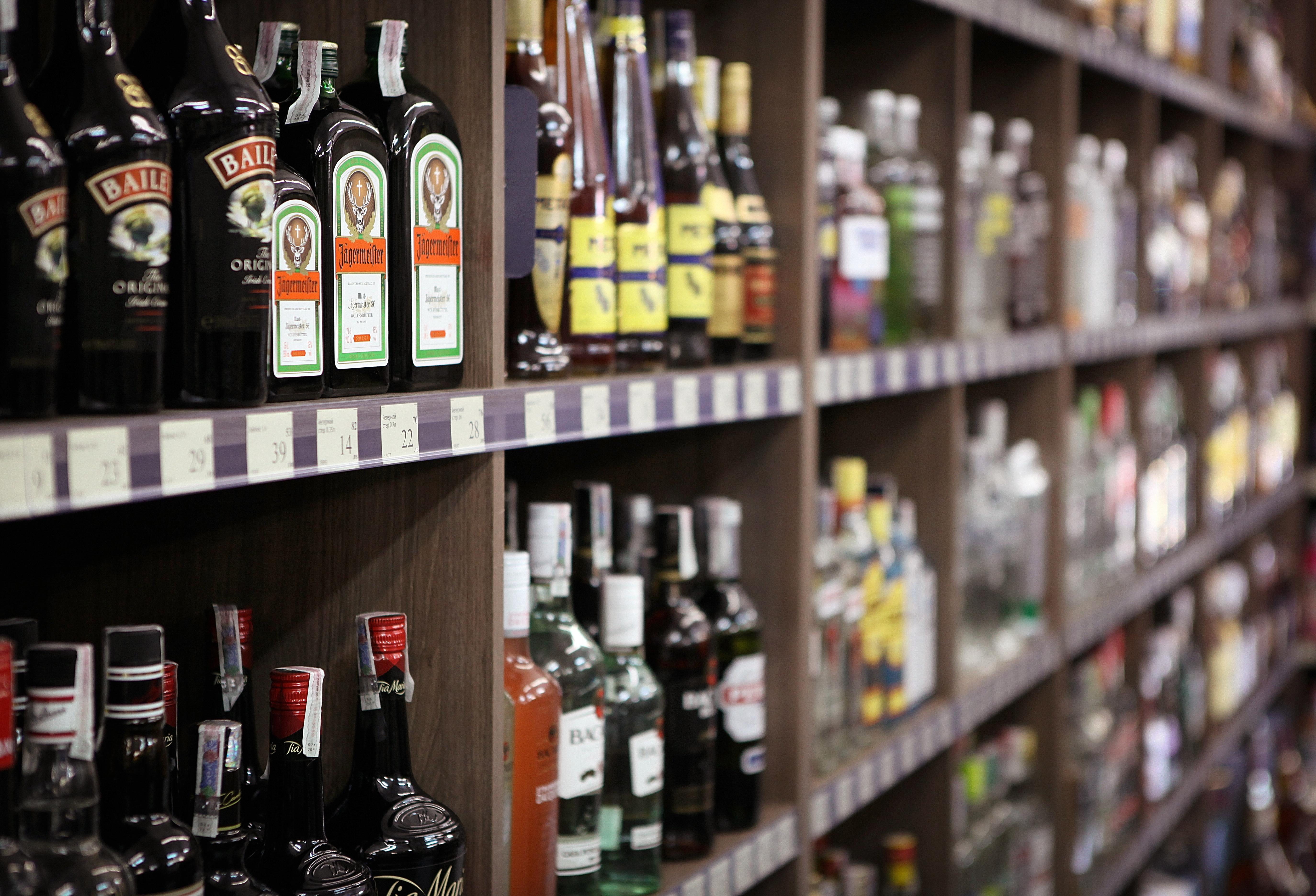 Shelves full of bottles of alcohol in a liquor store