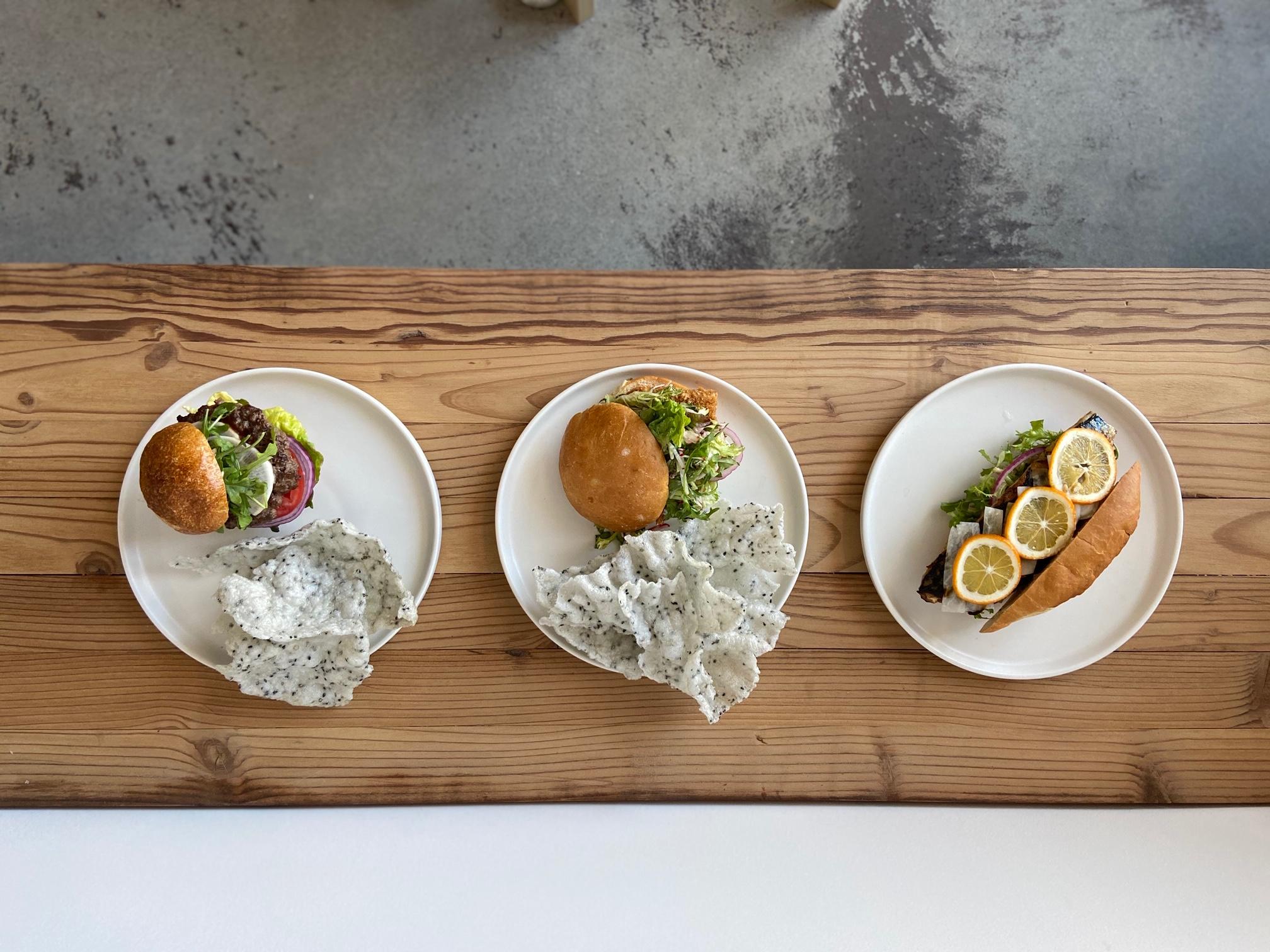 Wagyu burger (left), tuna belly burger, and saba sando at Masabaga