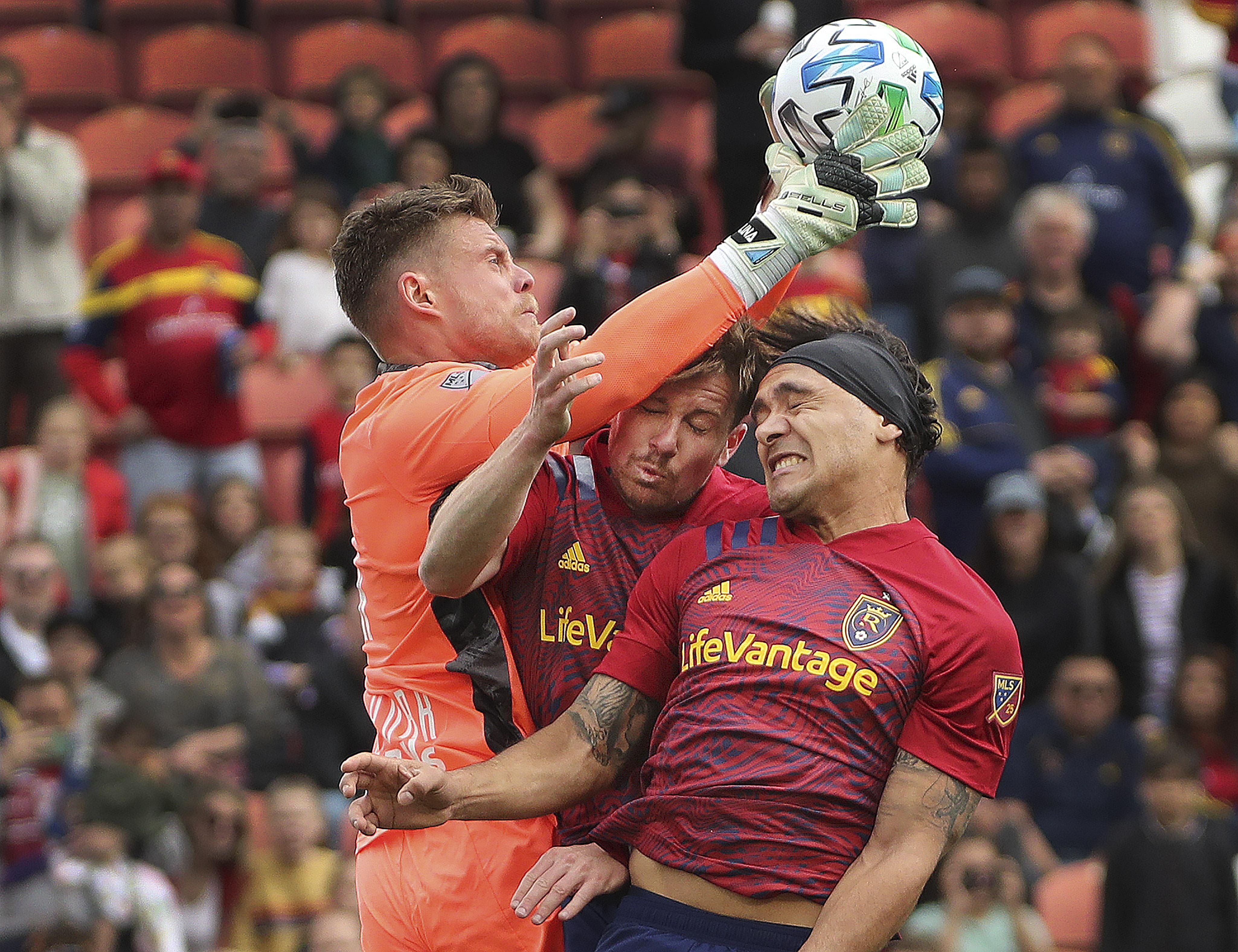 Real Salt Lake midfielder Nick Besler (13) and Real Salt Lake defender Marcelo Silva (30) try to head the ball as New York City goalkeeper David Jensen (1) grabs it in Sandy on Saturday, March 7, 2020.