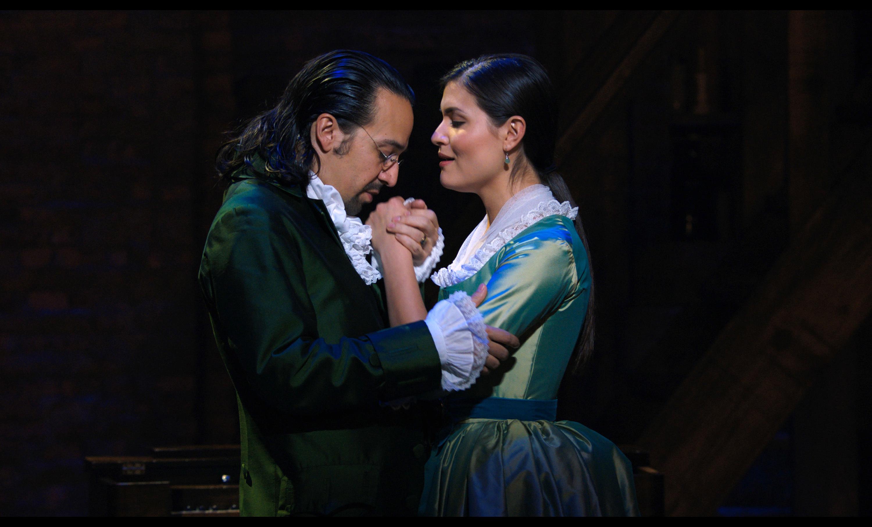 "Lin-Manuel Miranda portrays Alexander Hamilton, and Phillipa Soo portrays Eliza Hamilton, in a filmed version of the original Broadway production of ""Hamilton."""